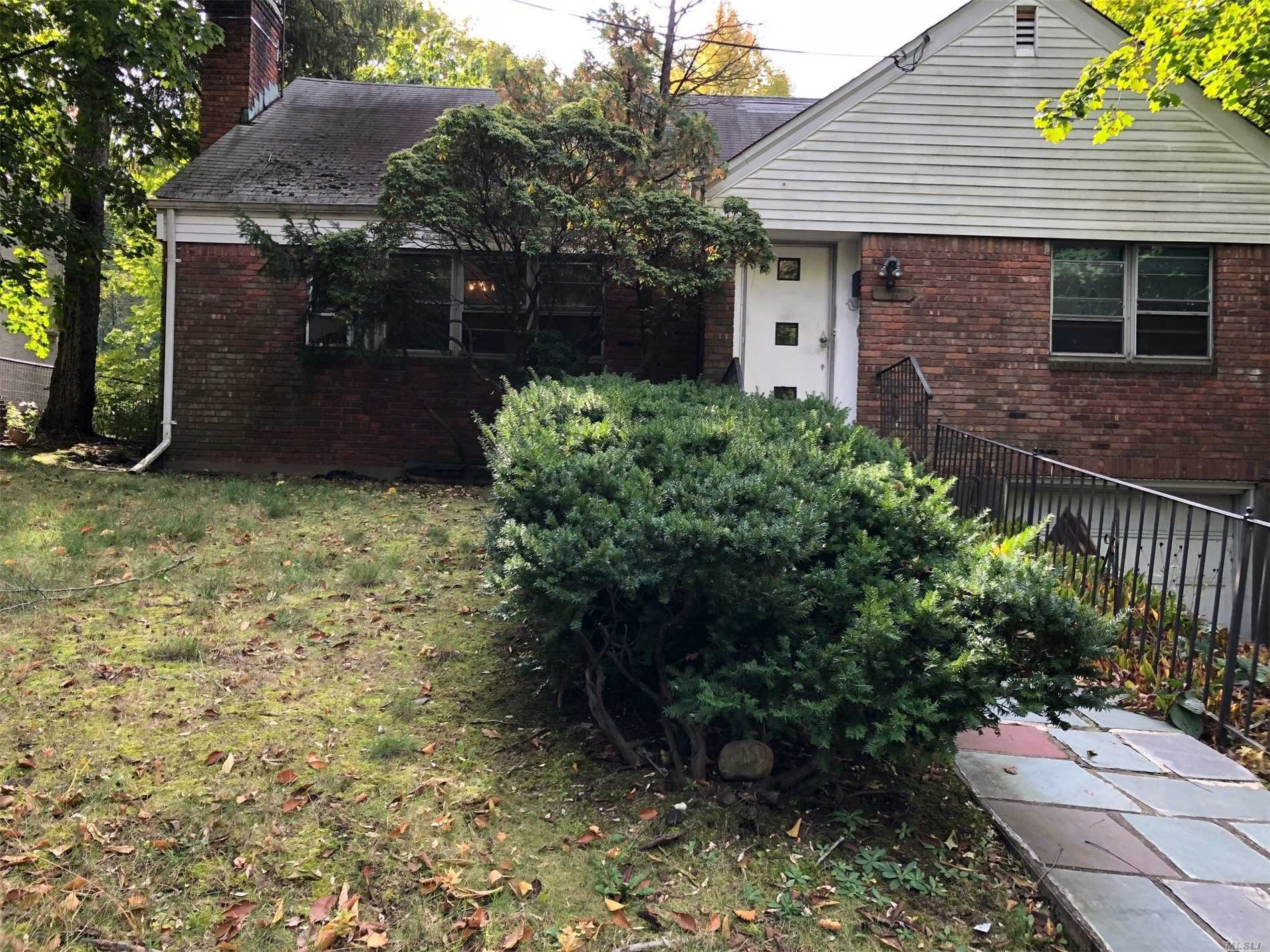 Great Opportunity To Make This 4 Br 2 Bath Cape Your Own. Large Wooded Property Conveniently Located To Town, Train, Shopping And Worship. Great Neck Park District. Property Is Sold As Is