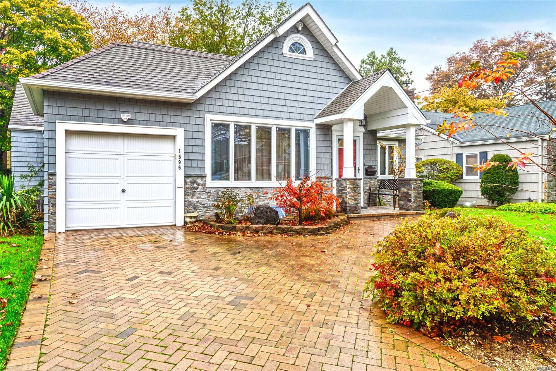 Expanded Updated Home In Highly Desirable Sd#14. Open Spacious Kitchen And Den With High Ceilings.  Plenty Of Space For A Growing Family 4 Bedrooms Two And Half Bathrooms Plus A Full Finished Basement. Super Quiet Block Truly A Great Location. Don't Miss This One