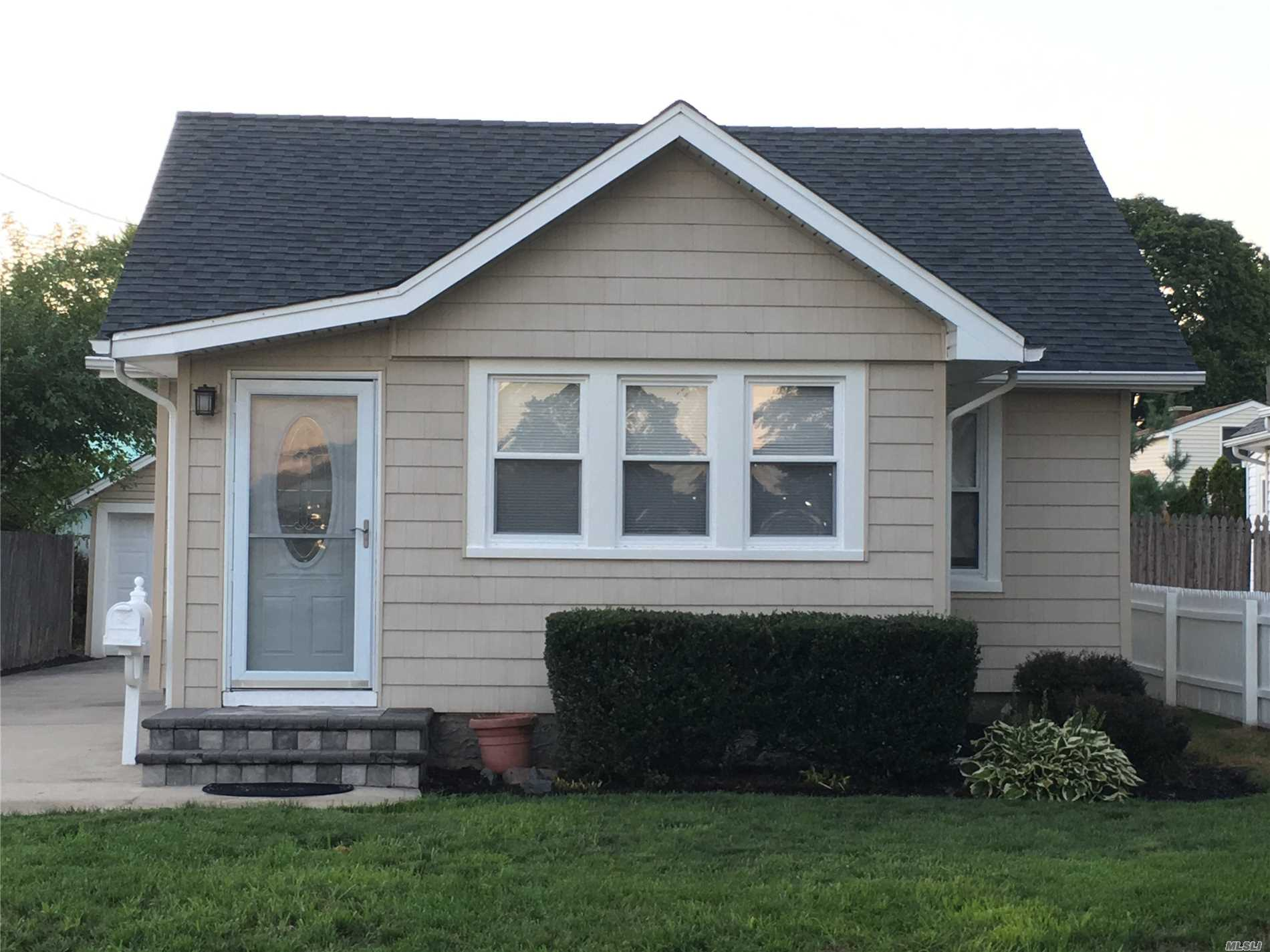 Move Right Into This Light And Bright Home, Complete With Washer And Dryer, Oversized Garage, Private Driveway And Backyard. This Home Features An Open Floor Plan, And Is Close To All - Transportation, Hospitals, Shopping And Restaurants. Note: Pictures Depict The Home When Vacant - Currently Rented. No Pets. As Per Town Of Brookhaven Rental Permit, Maximum Occupancy Is 2 Persons.