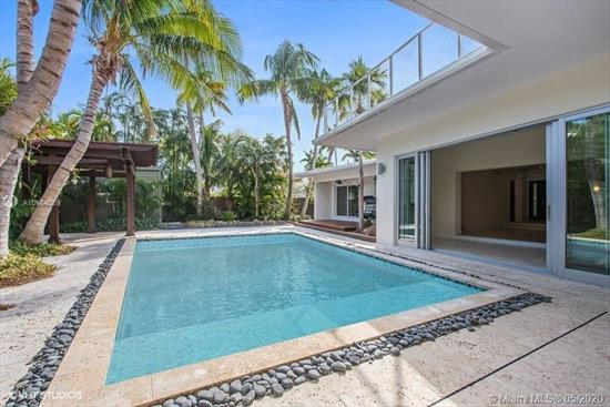 Enjoy Your Own Tropical Oasis In The Coveted Holiday Colony In Key Biscayne. Perfectly Located Steps From Sandy White Beaches Nestled On A Lush 12, 246Sf Lot. A Beautiful, Tree Trimmed Circular Driveway Welcomes You To This Spacious And Light Filled Home. The Foyer Entryway Opens To A Large Open Space With Views Of The Stunning Outdoors. Tall Sliding Glass Doors Lead You To A Backyard Featuring A Saltwater Pool, Gazebo, Ipe Wood Deck, And Large Entertainment Areas. Upstairs Media Room And Office With Architecturally Designed Windows, Wrap Around Balcony And Outside Entertainment Area. Boasting 4 Bd And 3 And 1 Half Bath. Formal Dining, Eat-In Kitchen And Family Room. Rich Oak Hardwood Floors And Marble Flooring. Easy To Show. Motivated Seller.