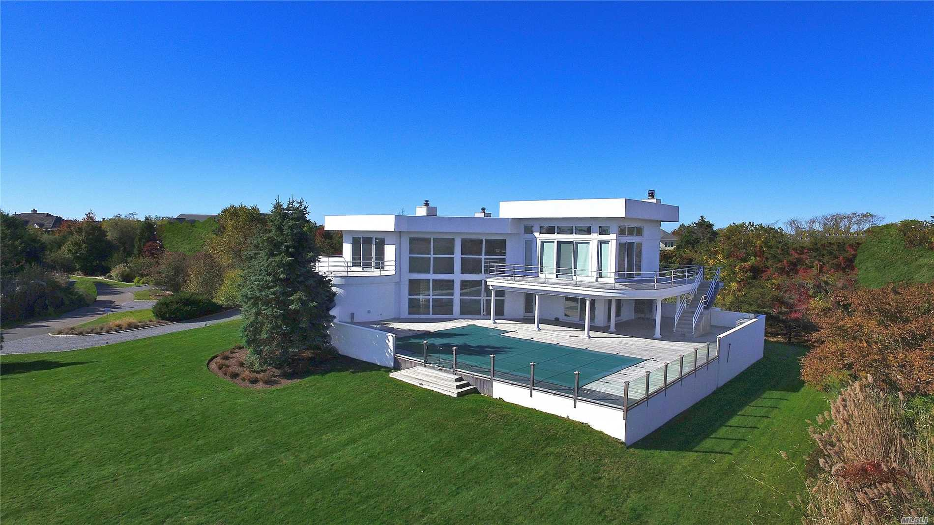 3.3 Acre Modern Masterpiece. 1st Floor W 5 Bed, 4 & 1/2 Baths, Media Room, 2 Car Garage, & Walk Out Decking. 2nd Floor W Open Living Area, Lr, Dr, Kit & 2nd Story Mahogany Decking. Vast Rolling Lawns, Lush Landscaping, Heated Inground Pool, Hot Tub, & Catwalk To The Private Deep Water Dock.
