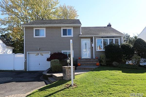 Gorgeous Split, Mid-Block, Completely Renovated From Top To Bottom. The Home Features Great Living Space, All Updated W/Granite Top-Of-The-Line Kitchen, Beautiful Updated Bathrooms, New Updated Finished Basement, Hardwood Floors Thru Out...Anderson Windows, New Patio & Much More On This Park-Like Property -- Plainview Schools!