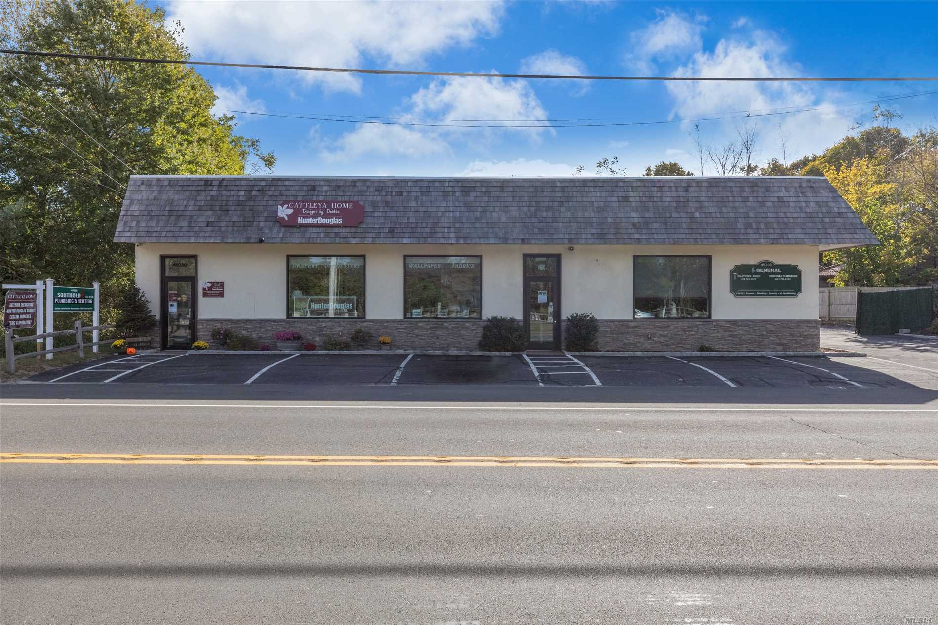 Opportunity Abounds! Multi-Purpose Building With Two Separate Retail Or Office Suites At Highly Visible Main Rd Location. Each Suite Has Their Own Updated Bathroom Facilities. Large 2 + Bay Storage Barn With Loft And Separate New Morton Building.1980 Sq.Ft. Office.Retail, 1031 Sq.Ft. 2+ Garage, 422 Sq.Ft. Morton Building.