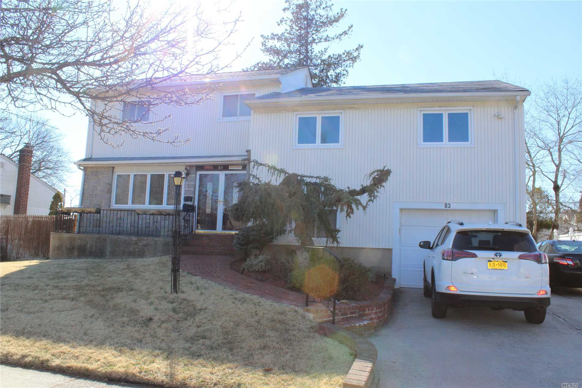 Lovely Mid Block Large 5 Bedroom 3 Bath Split W/Granite Kitchen And Ss Appl. Wood Floors Through Out Most Of The Home/Separate Office And Finished Basement. Dining Room W/Sliding Doors Leading To Deck. New Roof, New Boiler Great Home Must See!