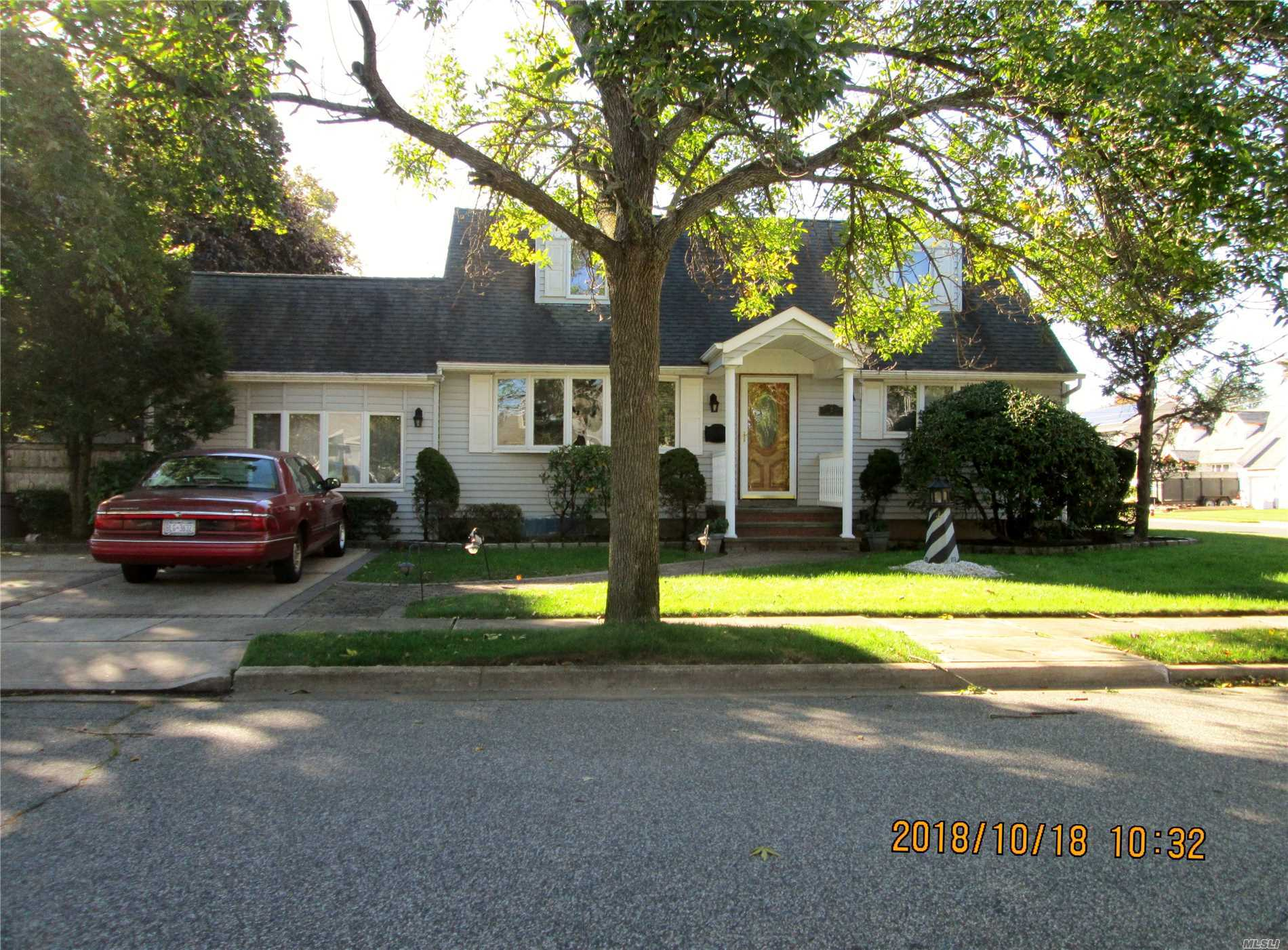 Beautiful Expanded Cape In Plainedge Sd#18. Large Living Rm, Eik, Formal Dining Rm, Full Bath And Master Bdrm With California Closets. Family Rm With Cathedral Ceilings. New 1/2 Bath. Upstairs Has Large Bedroom And Framing For A 4th Bedroom. Basement Is Part Finished. Hardwood Floors. Generator Included. **Tax Grievance Has Been Approved For A 19% Reduction**