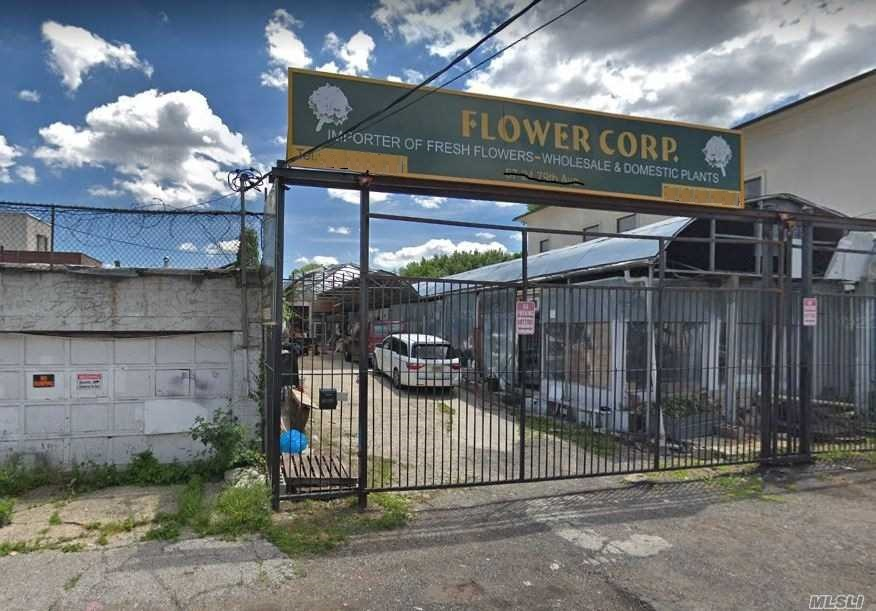Empty 4900 Sqft Lot For Rent In Ridgewood. Concrete Ground With Small Office.