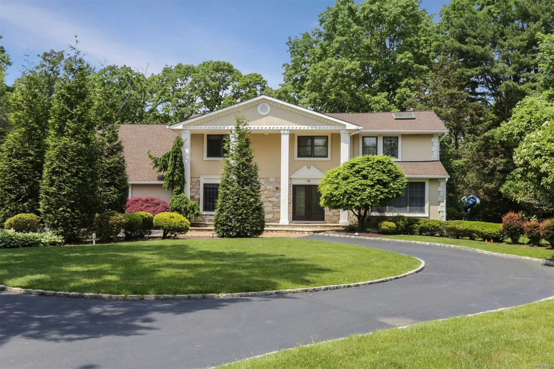 Impressive Colonial With Modern Flair Privately Situated On Flat Country Club Acre In Cul De Sac. Sought After Round Swamp Rd. Location Is Convenient To All.This Distinctive Home Offers Circular Drive, Grand Marble Entry, Rich Wood Floors, Full Guest Suite Off Kitchen, Front & Rear Staircases, 4 Br's Upstairs + Fabulous Bonus Room!Lush Resort Style Property With Pool, Pavers & Plenty Of Room To Play.Legal Finished Basement.Half Hollow Hills Schools.