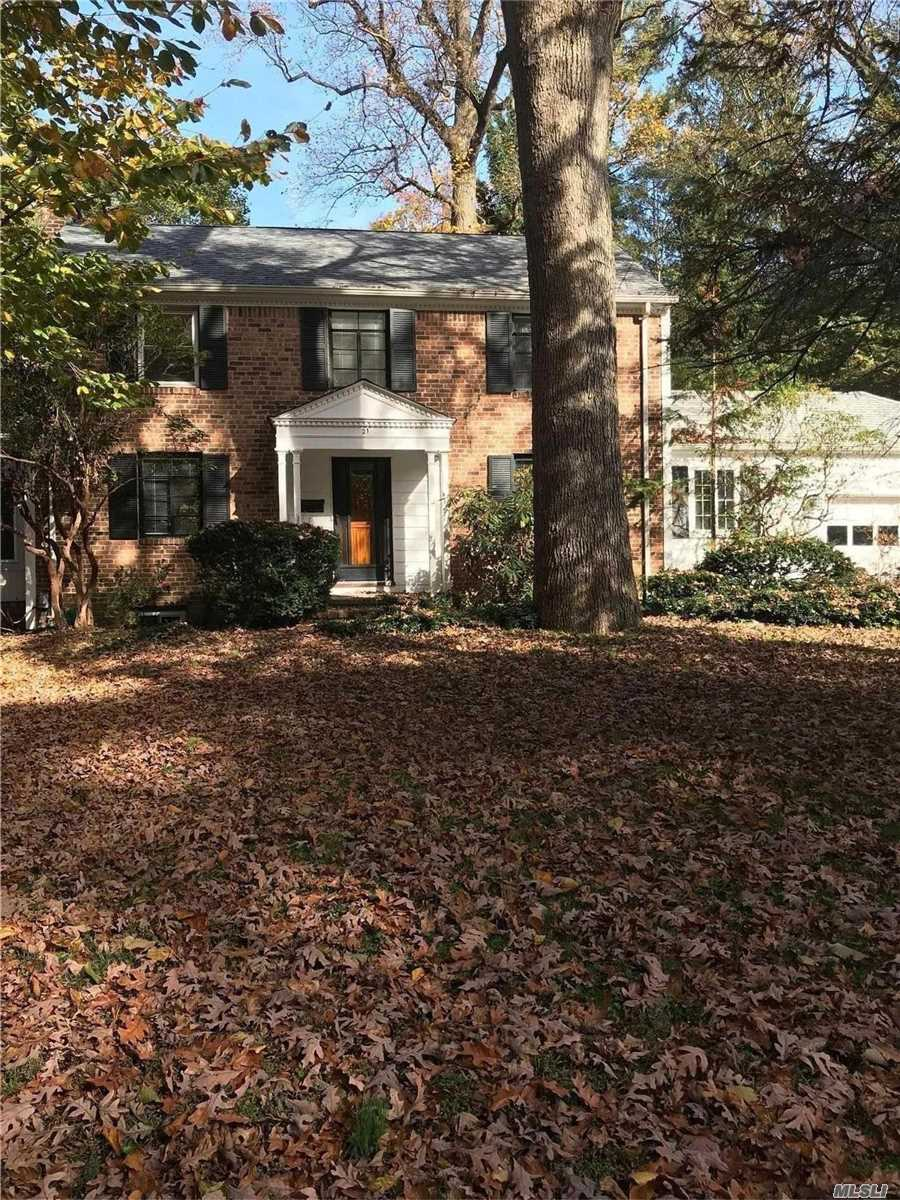Totally Renovated Baxter Estates Colonial, Gourmet Eik, New Bathrooms, Incredible Storage, Finished Lower Level, Wood Floors Throughout, Formal Lr W/Fpl, . Close To Town & Rr, Across From Baxter Pond, Private Large Rear Yard With Patio.