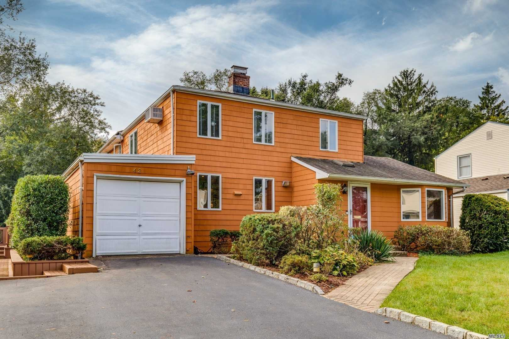 Spacious And Bright Expanded Colonial Is Set On Beautiful Property With Desirable Roslyn Schools. Open Floor Plan Designed To Accommodate Five Bedrooms If Needed. Sliding Door Opens To Rear Wrap Around Deck Expanding Your Life To The Outdoors. Location, Value And Space Makes This Home A Must See, Call Today.