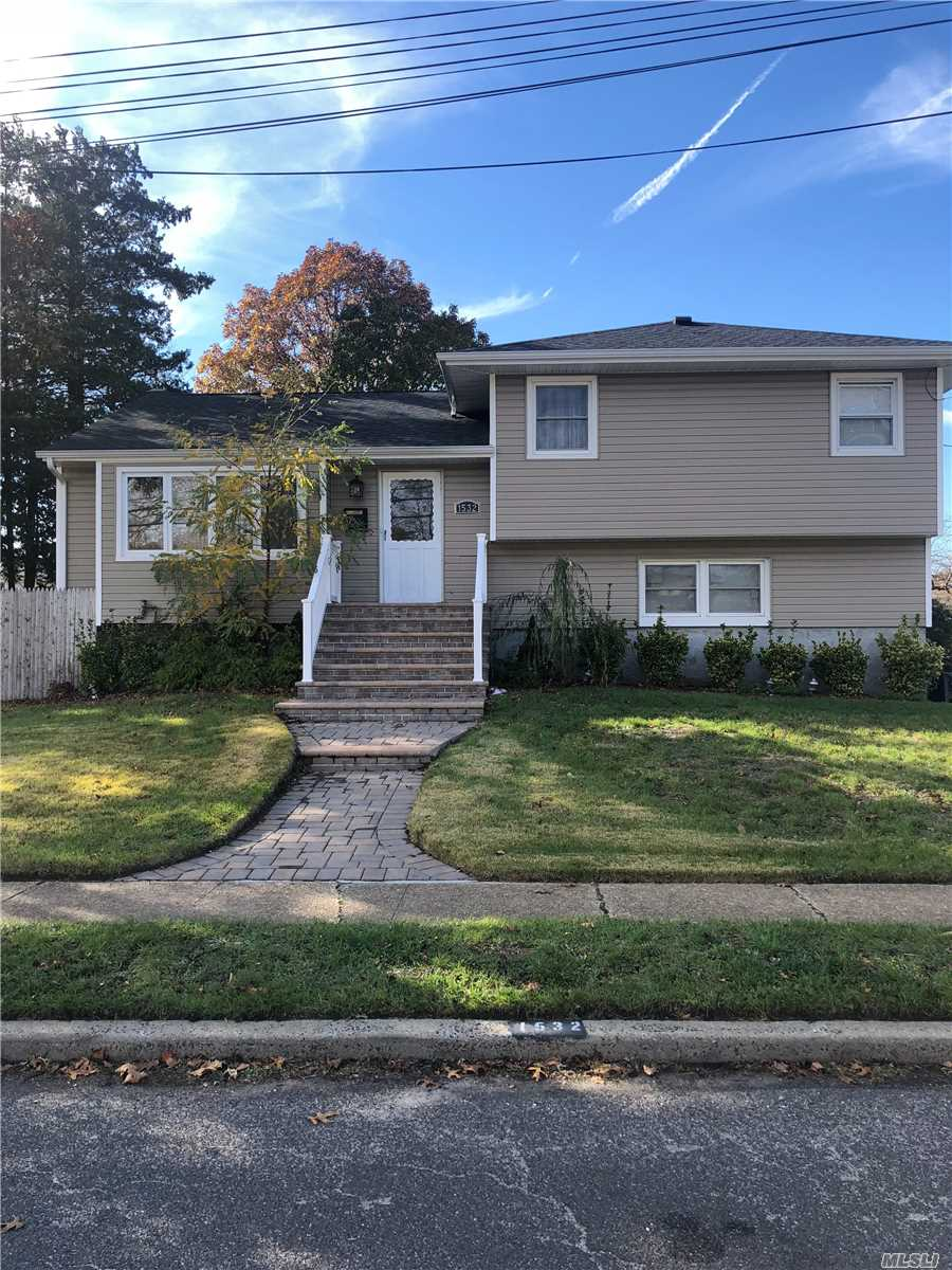 Beautiful Well Maintained Split Updated Kitchen, Stainless Steal Appliances, Granite Counter Tops, Central Air, Inground Sprinkler, Fenced In Yard With Manicured Landscaping, Loaded With Updates