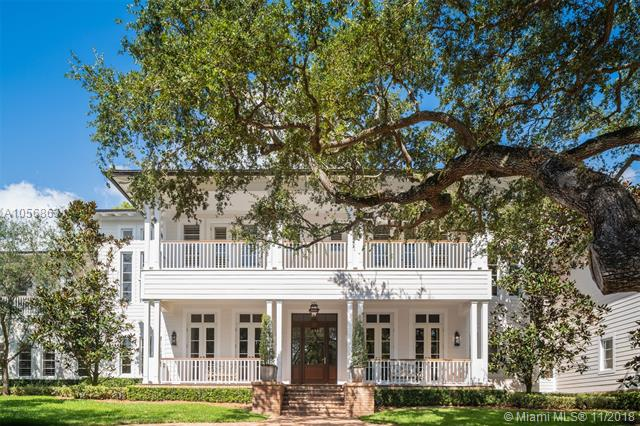 Captivating Plantation-Style Estate, By Renowned Architect David Johnson, With The Finest Modern Appointments Sitting On A Sprawling Oak-Laden Cul-De-Sac In Cocoplum Phase 1. Stunning Rich Wood Floors Throughout, Detailed Tongue & Groove Coffered Ceilings, Fireplace And Built-In Bar Unites The Temperature-Controlled Wine Cellar. The Chef-Inspired Kitchen Opens To A Large Patio W/Summer Kitchen That Wraps Around The Back Of The House & Overlooks The Backyard & Swimming Pool. First Floor Has An En-Suite Guest Room, Service Quarters & Powder Bathroom. The Second Floor, Accessible Also By Elevator, Has Stately Master Suite, 3 En-Suite Bedrooms, Add'L Family Room & A Guest Suite Connected By A Covered Breezeway. 3-Car Garage W/Height For Lifts, If Desired. Impact Windows & Whole-House Generator.