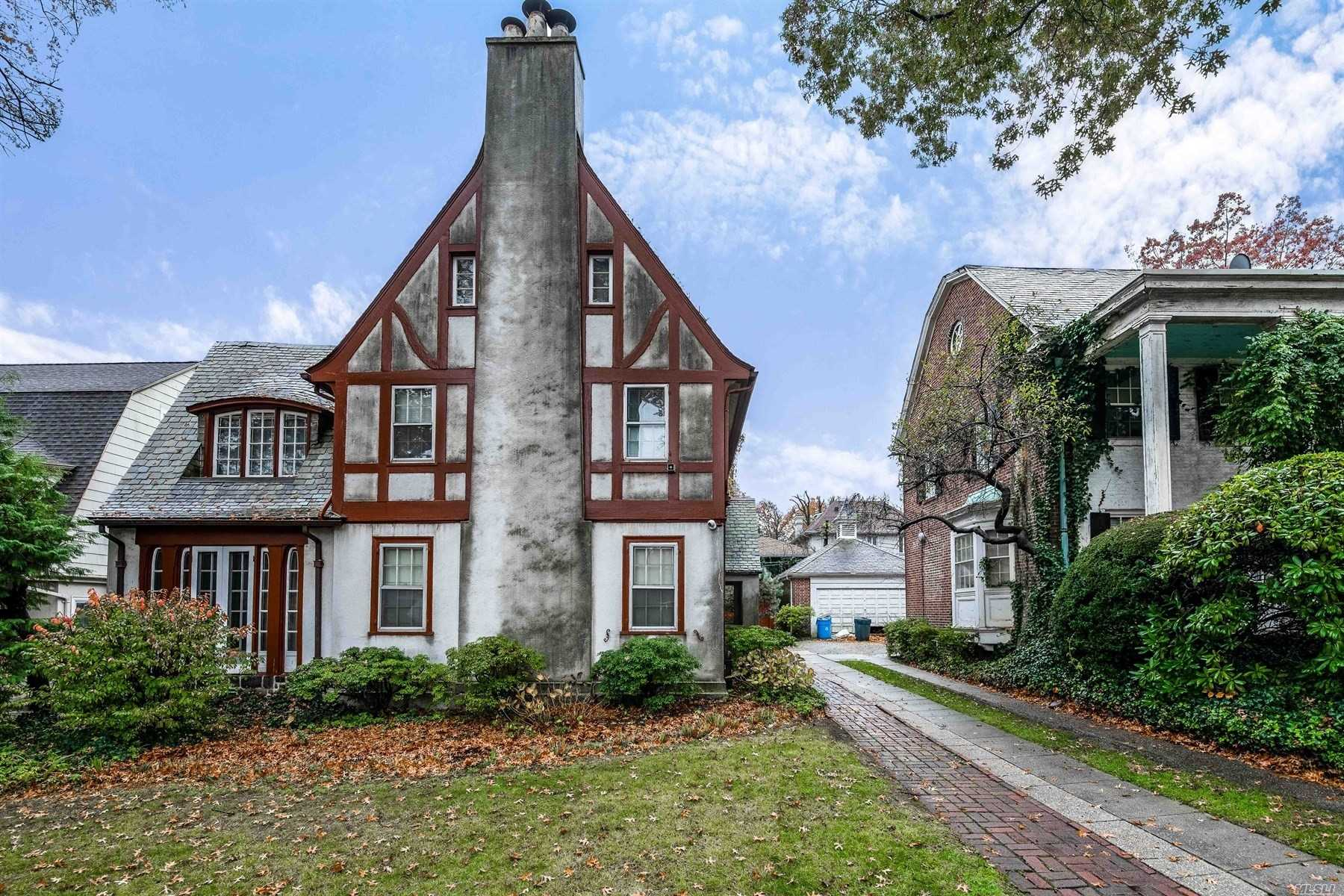 1 Family Tudor With Charm And Character In The Heart Of Kew Gardens - Hardwood Floors - Elegant Original Woodwork And Exquisite Stained Glass Windows - 2 Fireplaces - Slate Roof - Herb And Vegetable Garden - Back Up Generator Connected To The Gas Line (2Years Old) - Surveillance Camera - 3 Ceiling Fans - Chandelier In Dining Room Excluded - Wine Cellar In The Basement