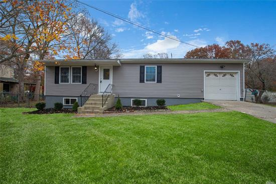 Perfect Starter Home. Gorgeous, Spacious And Newly Renovated 3Br, 2Ba Ranch Features Espresso Kit, Granite Counters, Ss Appliances, Hand Scraped Floors, New Roof, New Windows, And New Siding. Fully Finished Basement W/Ba. All On 1/2 Acre Lot With Endless Opportunities.
