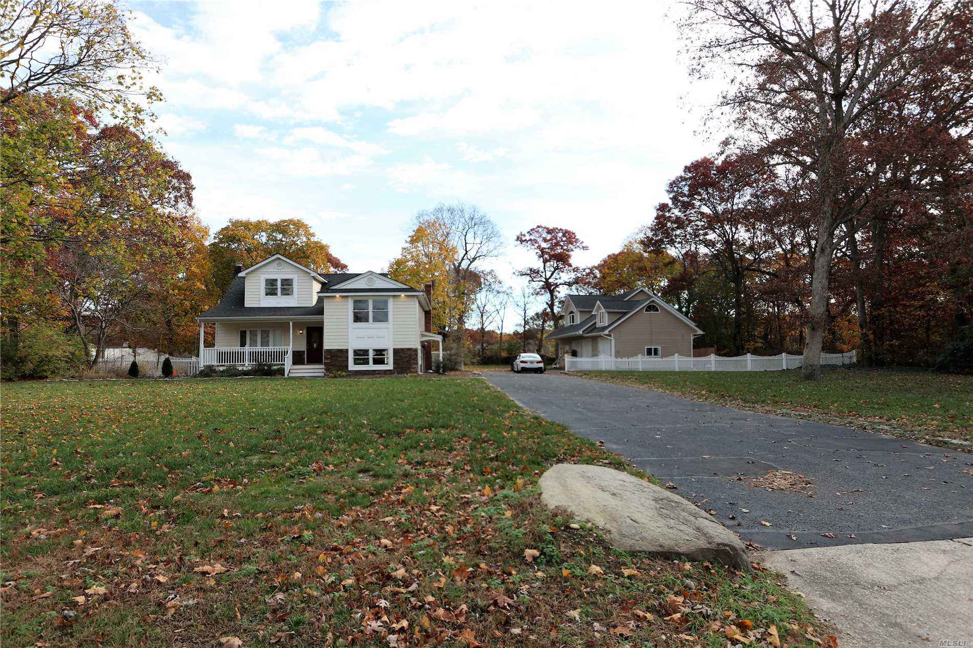 Large 5 Br., 3.5 Bath Updated Split Level Home With Det. 4 Car Garage On 1.25 Flat Acres In Desirable North Coram On A Great Quiet Street. Features Oak Floors, New Baths And Kitchen (Whole House Was Renovated 3 Yrs Ago) Huge 2 Story Detached Legal 1500 Sq. Ft. 4 Car Garage W/ Loft. All C Of O's Are In Place. This Home Has Endless Possibilities