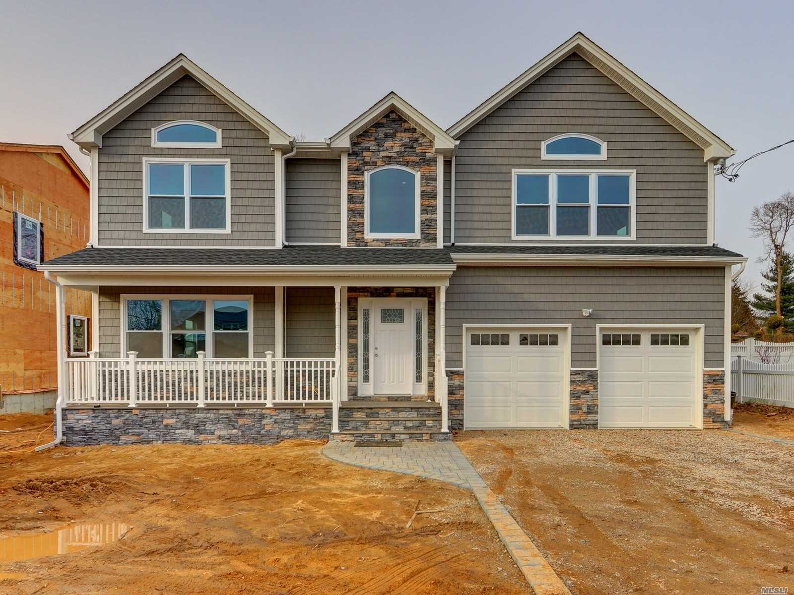 Brand New Construction! Massive 3400 Sf Custom Colonial 4 Bedroom, 2 1/2 Bath With Open Floor Plan On 65 X 140 Lot. . Gas Heating And Cooking. Gas Fireplace. Huge Master Bedroom Suite. Full Unfinished Basement W 8-Foot Ceilings And Outside Entrance. Vinyl Siding And Cultured Stone, Anderson Windows, 200 Amp Service, Hi-Hats Galore, Crown Molding, Hardwood Floors Throughout, P/D Attic. Front Porch, Oversize Driveway, 2 Car Garage.