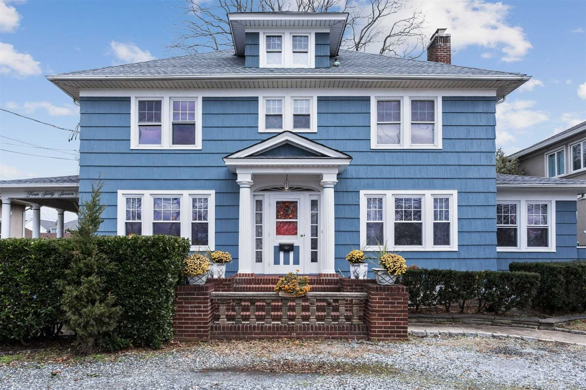 Waterfront Living On Deep Canal! Center Hall Colonial On An Oversized Property. This Home Features Hardwood Floors Throughout.  3 Bedrooms, 3 Full Baths, Livingroom With A Wood Burning Fireplace 63 Feet Of Marine Bulkhead A Must See!