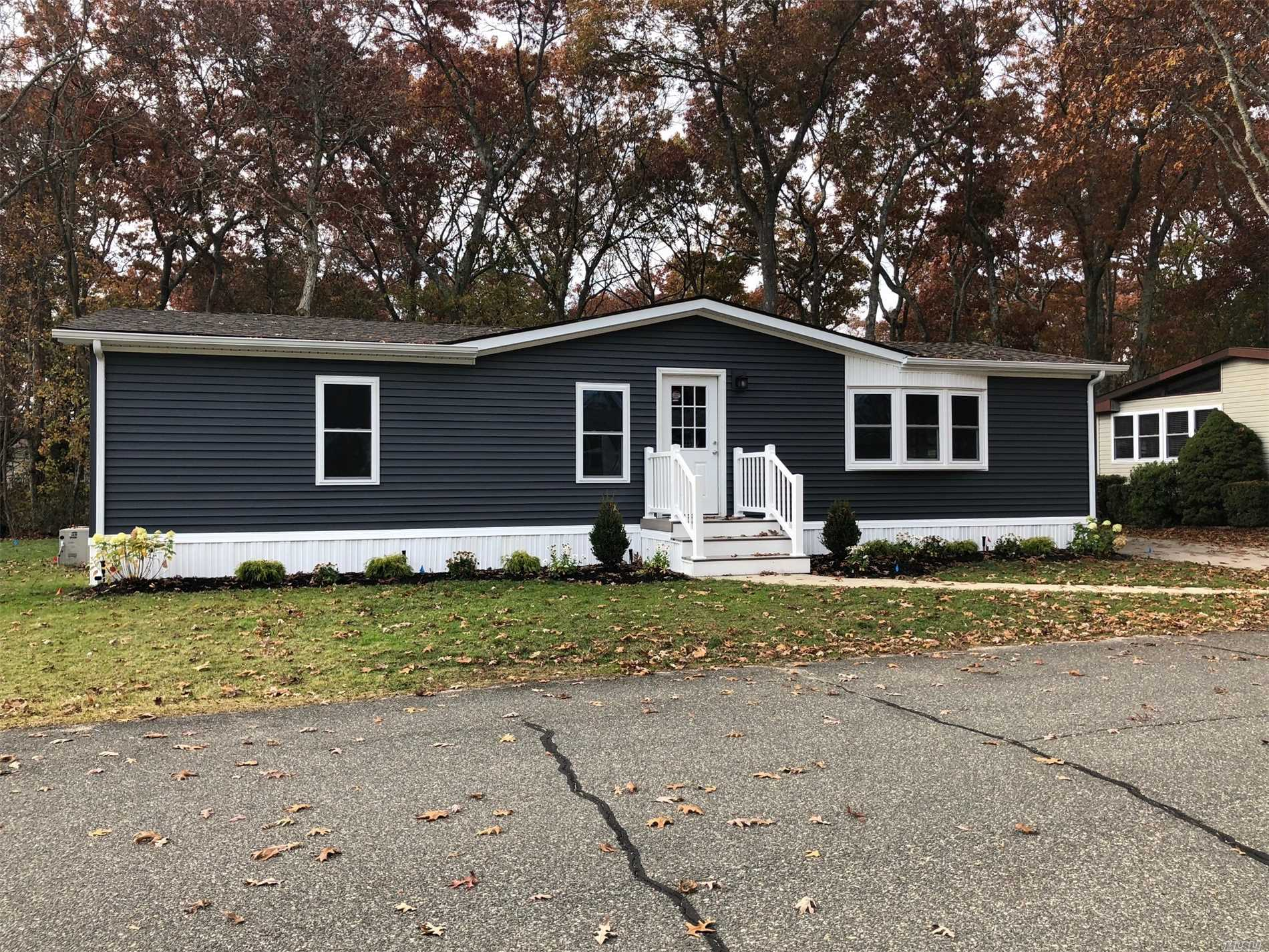 Home Has Been Completely Renovated! 2 Bedroom, 2 Bath, Lr Dr, Handicap Ramp At Rear Of Home. New Windows, Roof, Walls, Kitchen, Flooring, Plumbing, Baths, Decking, Rails, Skirting, Landscaping, Sprinkler System & New Hot Water Heater.  - Oil Heat, & Central Ac