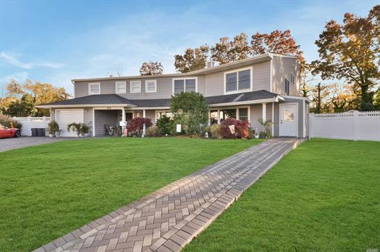 Magnificent One Of A Kind Two 2100 Sq Ft Side By Side Splits Under One Roof Set On A Beautiful Cul-De-Sac In Wantagh.This Home Features Hardwood & Marble Flrs, 7 Yr Old Andersen Winds, Roof, Siding & Heating System, Updated Baths & Kitchens W/Granite Counter Tops & Ss Appls, 8 Bedrooms, 2 Eik's, 3 Full Baths, 2 Half Baths, 2 Dining Rooms, Living Rm, Trex Deck, Fully Fenced Private Yard, Ag Pool, 2 Car Det Garage, Grievance Awarded 31% Reduction $9920 Included, Close To Schools, Shopping, Restaurant & Trans.