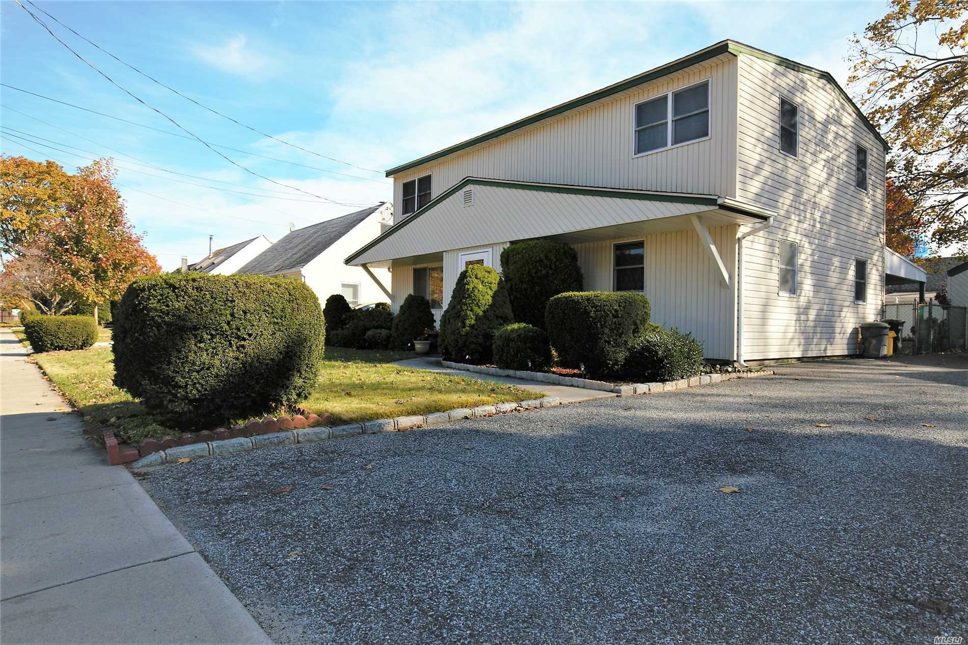 Too Much Of House For Money. Approx 1820 Sqft Livable Space , Extended Eat In Kitchen With Formal Huge Dinning Room Extention, Huge 4 Bedrooms And Potential For Big 5th Bedroom, 2 Full Bath , One Bath On Each Floor, Very Conveniently Located Close To Highways, Groceries, Shopping Etc. Approx 1 Mile To Lirr. One Year Young Roof, Gas Heat,  New Appliances , 200 Amp Electricity, Priced Right For A Quick Sale, Covered Patio, Wont Last ! A Must See House !
