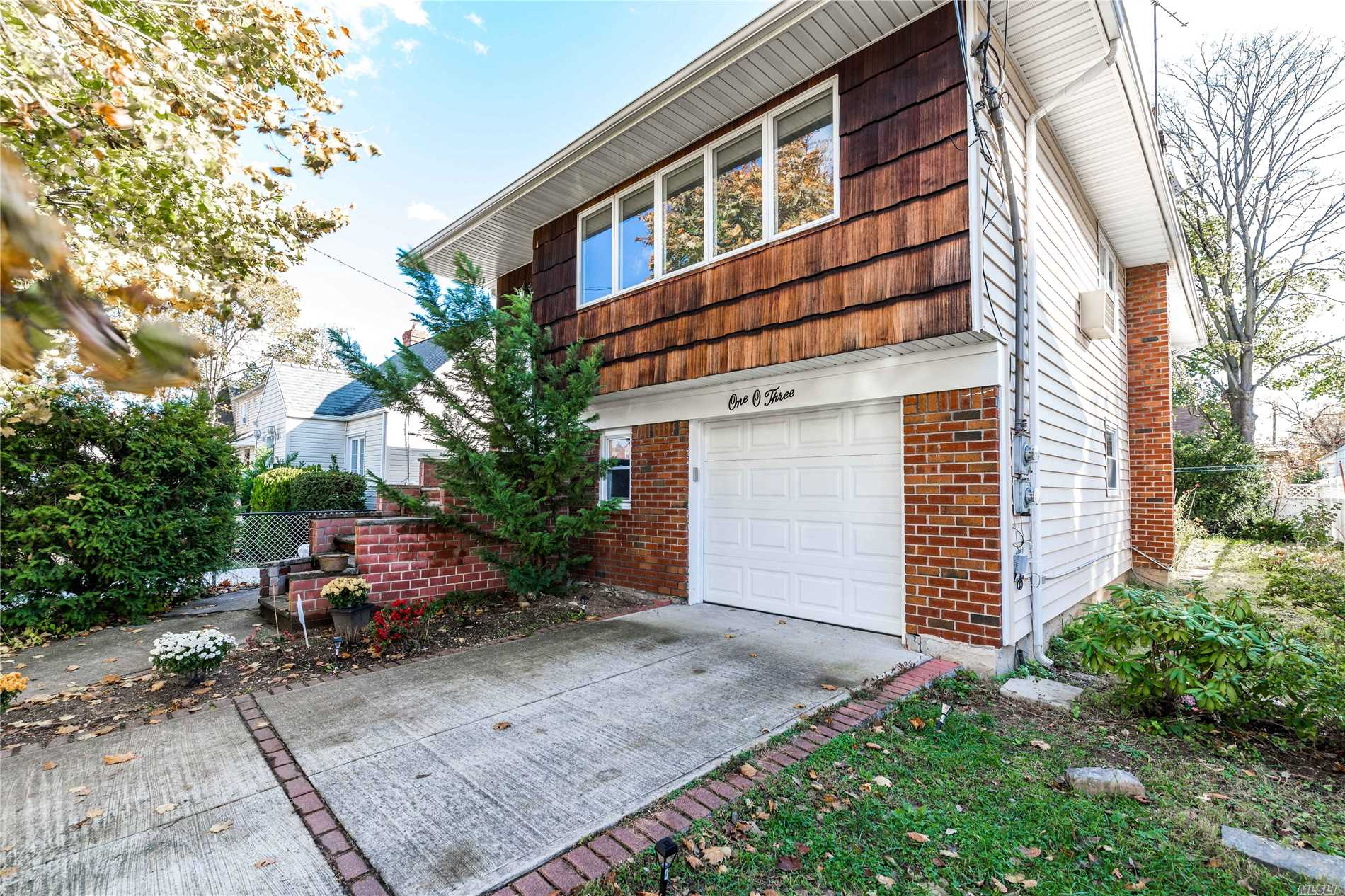 Spacious Contemporary Hi Ranch. Great Layout! Updated Eik And Baths. Well Maintained Boiler And Separate Hot Water Heater. 4 Year Old Roof, Siding And Fence For Yard. Shows Well!
