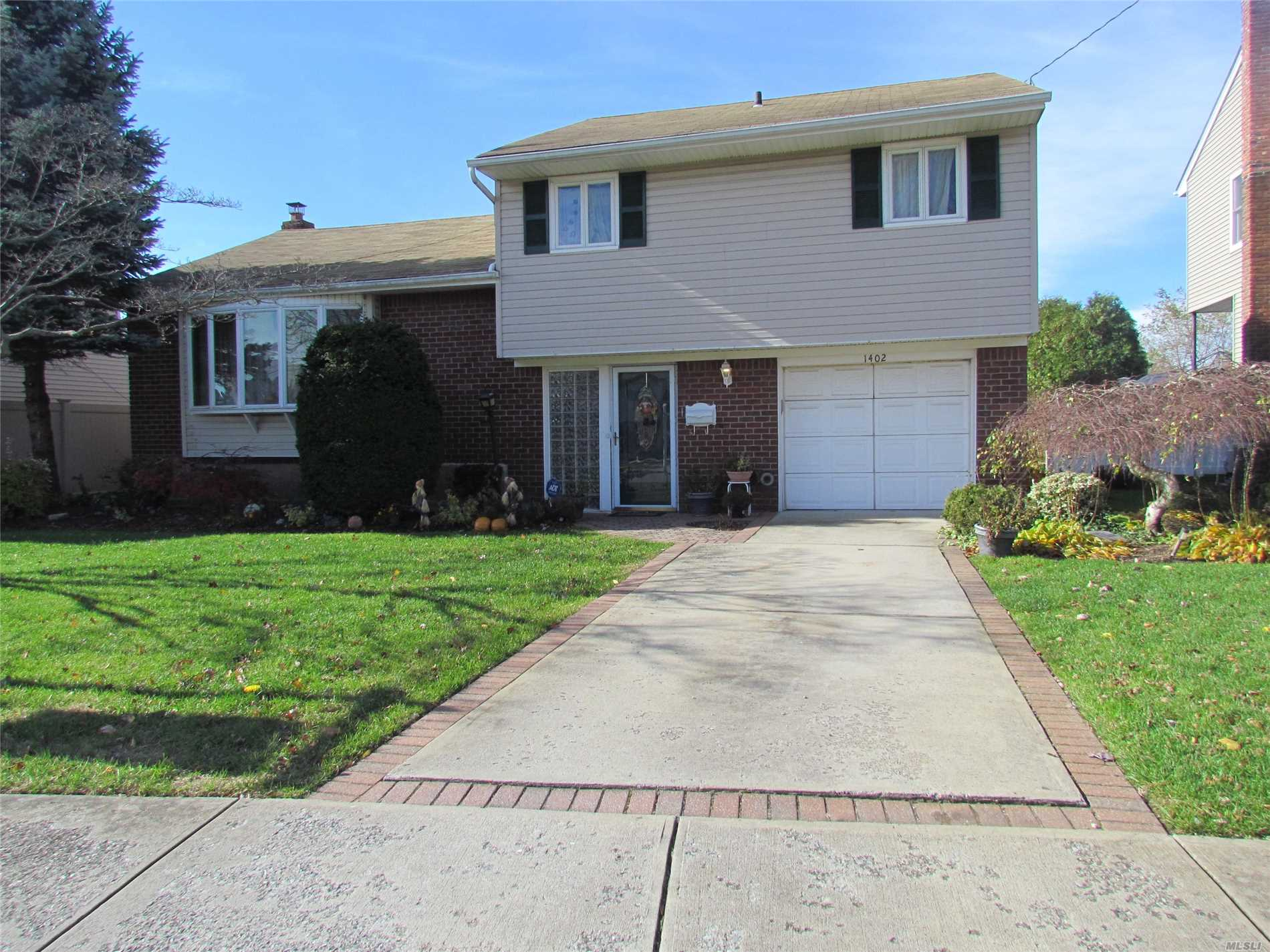 Lovely Split In N. Bellmore. 4 Bedrooms, 2 Bathrooms, Large Den. 2nd Story Bath Has Dual Entry To Hall And To Master With Private Tub Area. Living Room/Dining Room Hard Wood Floors. Eik With Sliders To Deck Overlooking Oversized Property. Taxes Have Never Been Grieved. Buyer To Verify All Information.