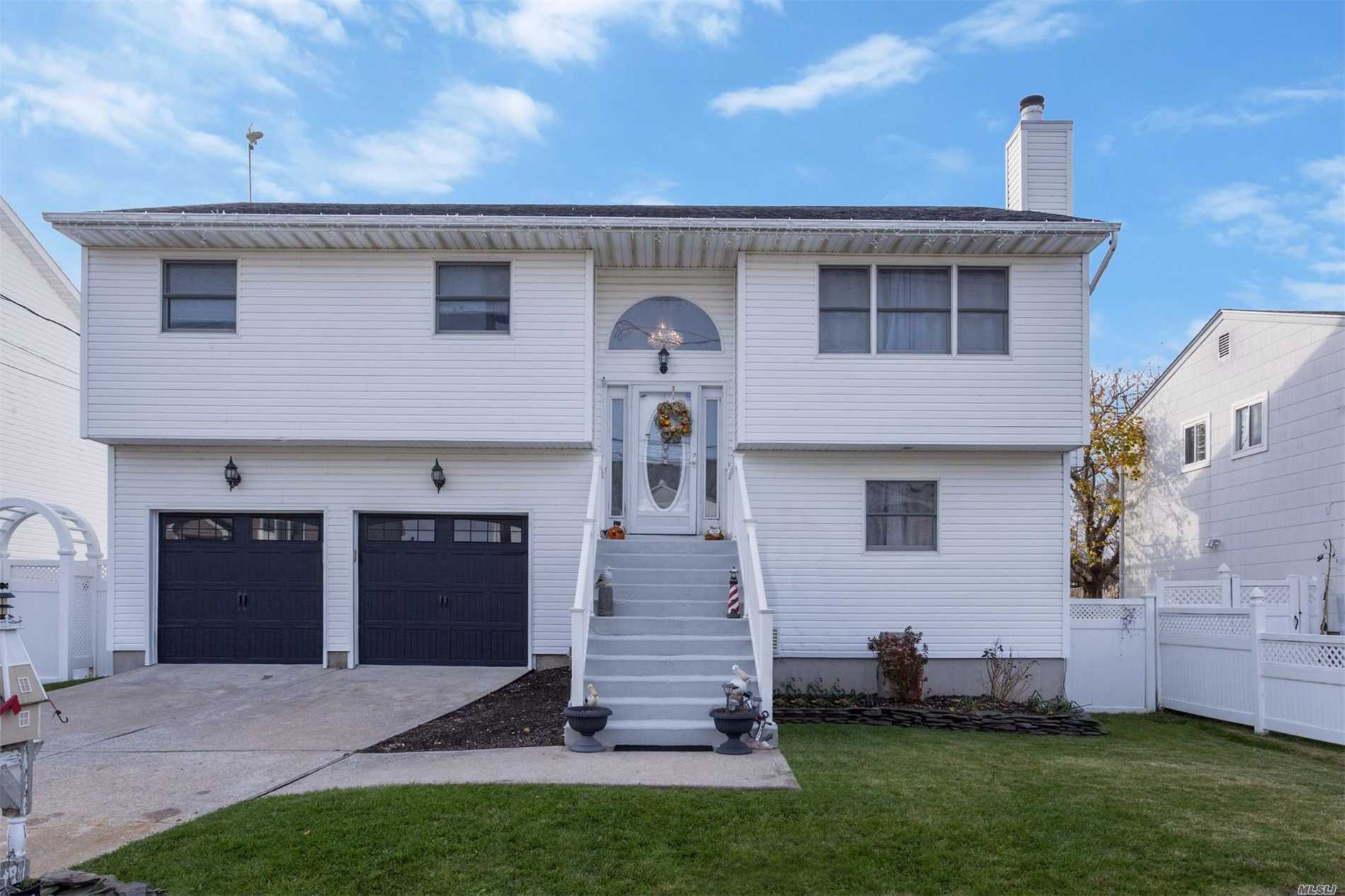 Built In 1997, This Beautiful Waterfront Home Features A Floating Dock And 3 Boat Slips. New Master Bath, New Cac, New Hardwood Floors, New Garage Doors, New Dishwasher, Ceiling Fans, Hi-Hats, Full Crawl Space Under Laundry Room - Alarm System, Living Room W/Fireplace, Spacious Eik, Fdr W/Sliders To Upper Deck And A Great Fenced In Yard Complete This Home....
