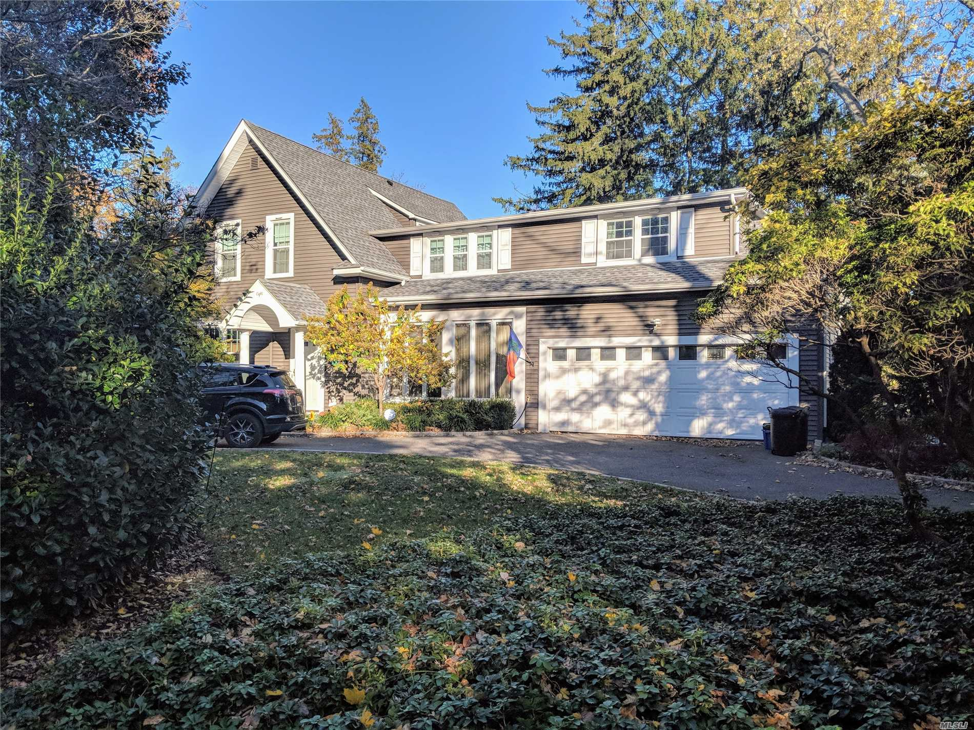 This Large Redone Colonial Has A Circular Driveway, New Quartz Eik, Wine Cellar, New Cac, New Roof, New Washer & Dryer, New Roof, New Windows, New Siding & Alarm System. Grand Rooms And Wonderfully Priced. Possible Mother Daughter .34 Acre. Walk To Train And Town.