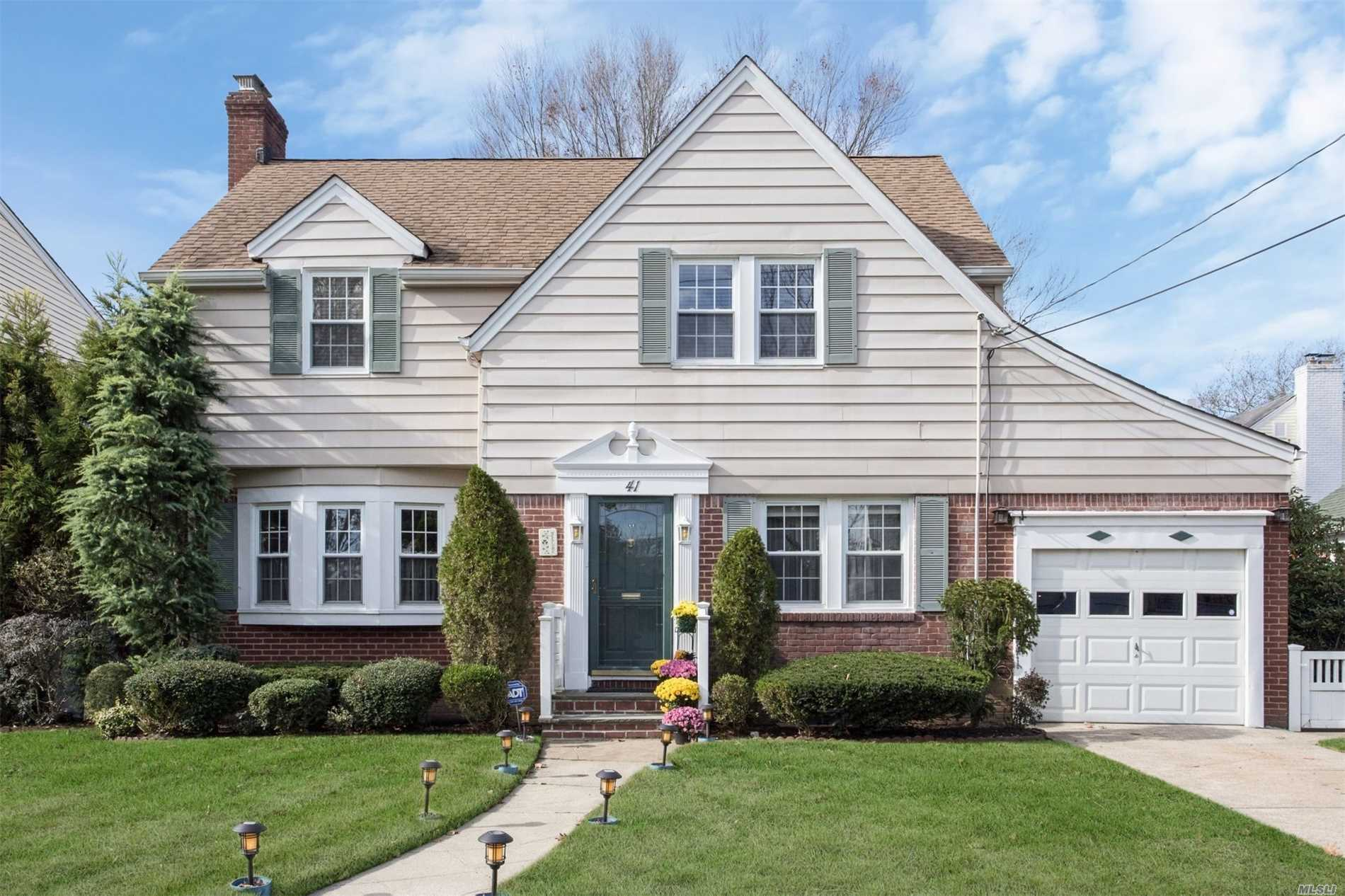 This Classic Center Hall Colonial Is Perfectly Situated In The Heart Of Malverne Village Near The Lirr, Shops And Parkway! Meticulously Maintained, This Home Is Waiting For You To Move In And Enjoy Your Cozy Living Room With A Fireplace, Eat-In-Kitchen Overlooking The Manicured Yard And Patio With Retractable Awning. Low Taxes Which Have Been Grieved!