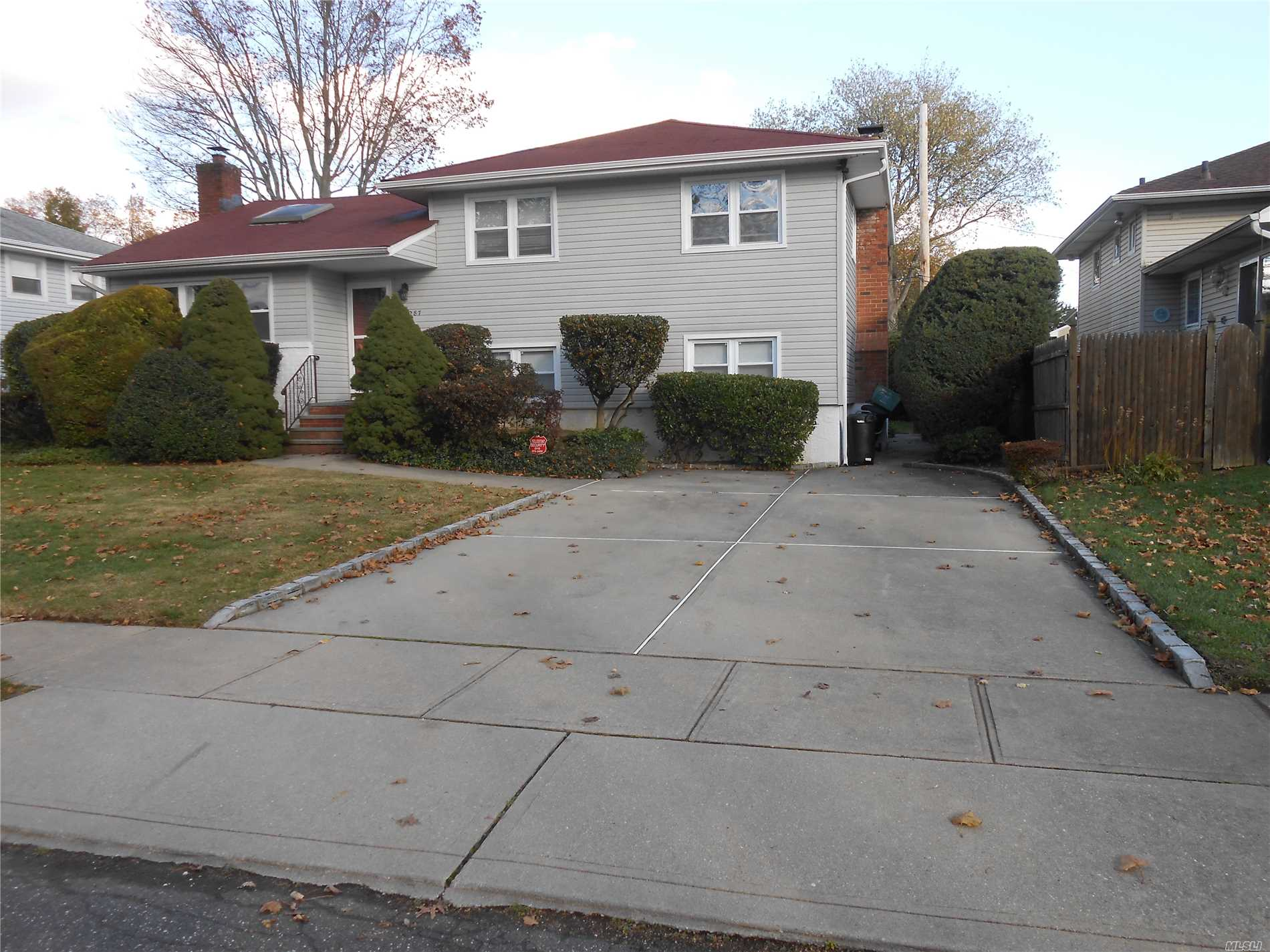 ...Plenty Of Updates And Award-Winning Schools!!! Recently Updated, Roof, Windows, Siding, Boiler, Hardwood Floors, Ss Appliances, Granite Counter Tops, New Master Bath Rm, Oversized Den/Family Room W/Wood Burning Fireplace, Alarm System,  Great Location!!! .... Tax Grievance Deduction Has Been Filed!!!  ....Come Make This House Your Next Home!!!