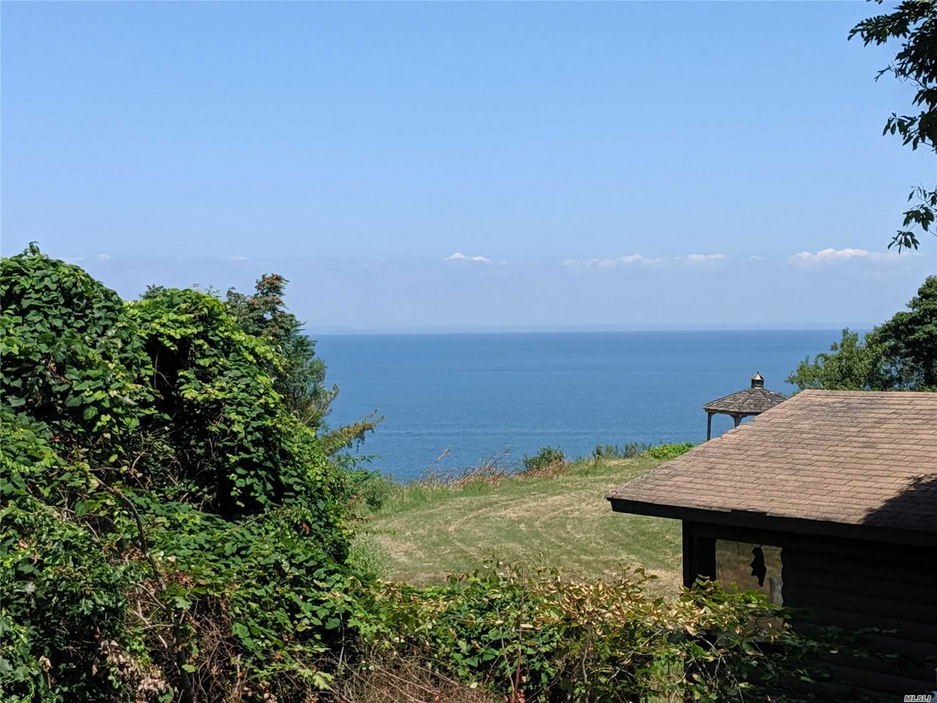 Wow, New Price! Sound Views! Looking For A Private Retreat? You've Found It In This Blufftop (No Flood Insurance Necessary!) Cedar Clad 3 Bedroom 2 Bath Home w New Kitchen, Baths, Large Deck Off Great Room. Master Balcony Offers Views Of Li Sound + A Peaceful Spot To Enjoy Cool Breezes. Hardwood Throughout. 15 Foot Deeded Right-Of-Way To Sound Beach. Basement w 9' Ceiling + Ose. Nearby Beach Allows Off Road Access. Enjoy The Wineries, Restaurants, And Shopping. The Perfect North Fork Getaway!