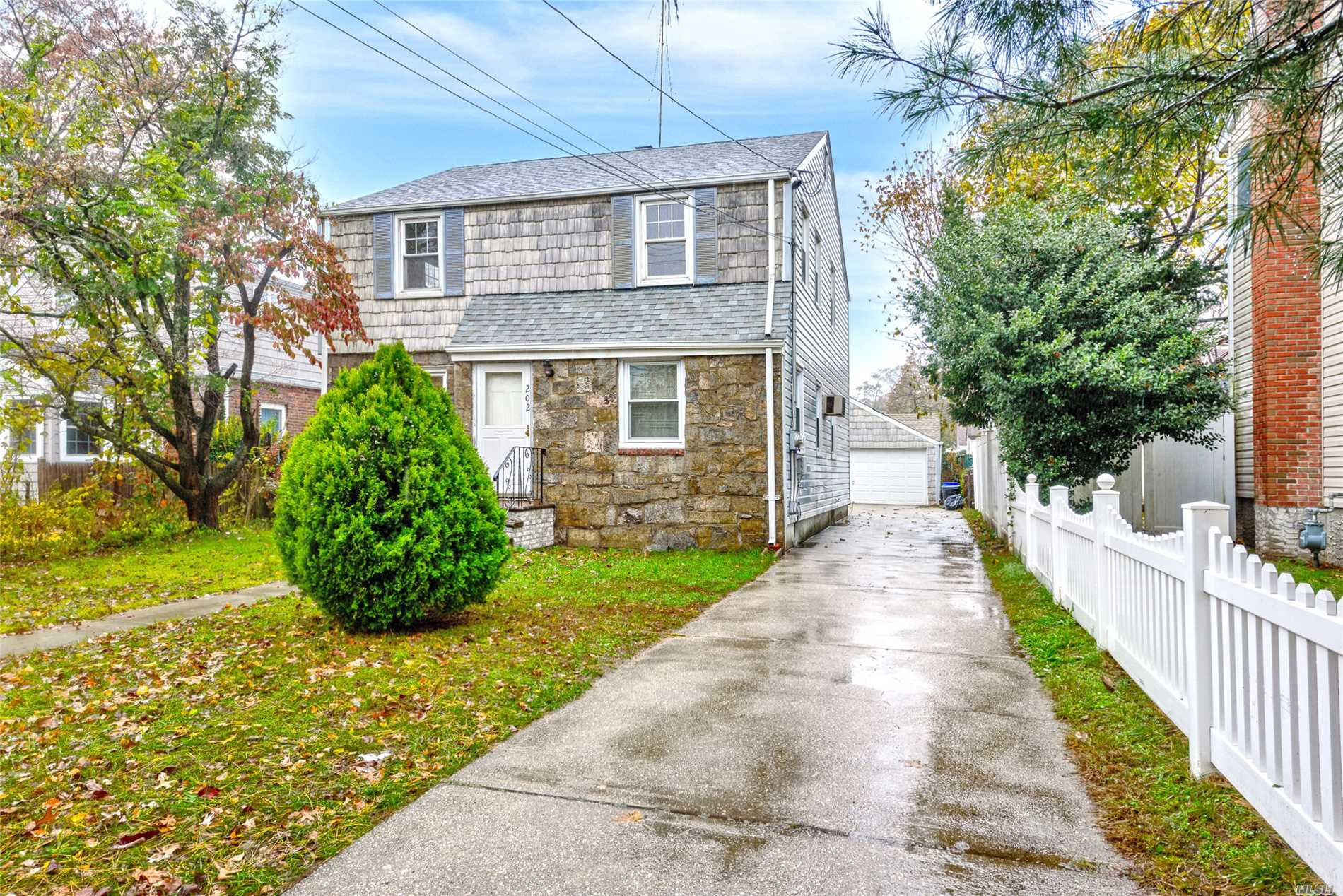 Mid-Block Westwood Legal-2 Family (W/Village), Features 2 Bdms/1Bath Over 2Bdms/1Bath & 2 Gas & Elec Meters. 1st Flr Features Lr, Lrge Eik W/Wall Oven, Stainless Fridge & D/W, Dining Area, Sunroom Off Kit, Hw Flrs Throughout & Replaced Windows 1st Flr & Bsmnt. 2nd Flr Freshly Painted, Living Rm & Bdrms W/Hw Flrs, Apt Kit Stove & Fridge Removed But Gas Stove Hookup Remains. Unfin Bsmnt W/Tons Of Storage, W/D, Ag Oil Tank & Ose. Arch. Roof, Vinyl Siding, 2-Car Det Garage & Long Driveway.