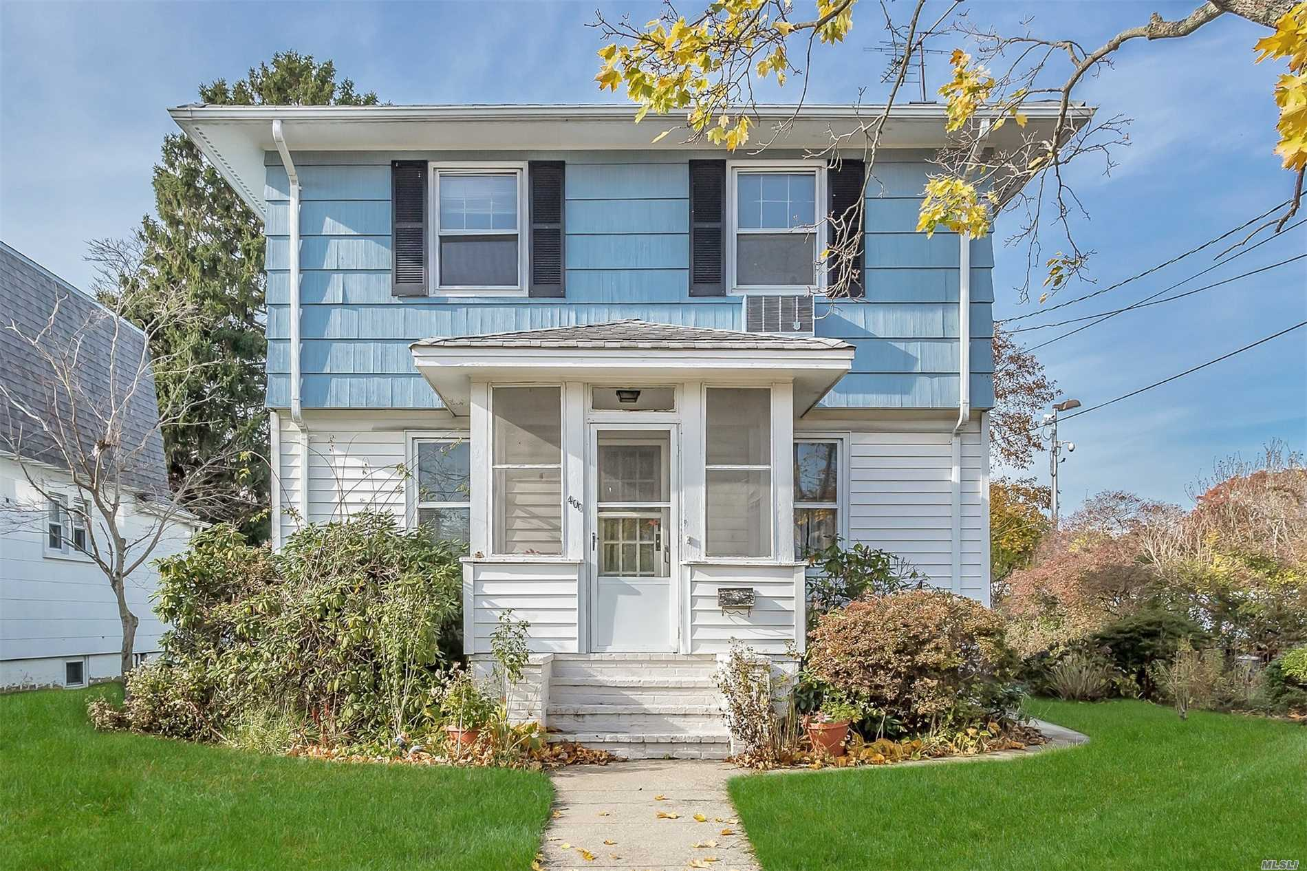 4 Bedroom, 2 Full Bath 1743 Square Foot Duplex Set On Oversized Property. Last House On Dead End Block. House Could Be Legal Mother/ Daughter With Proper Permits. House Has Updated Roof And Boiler. Needs Tlc. Close To Lirr