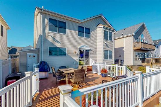Younger Waterfront Colonial With 50 Foot Of Updated Bulkhead, Spacious Paver & Composite Backyard And Great Waterviews. Flexible Layout Features Living/Dining Room With Vaulted Ceilings, Kitchen With Oversized Island Open To Den Area With Fireplace And Wall Of Windows Overlooking The Backyard And Water. Master Suite With Skylight, Walk In Closet And Private Bath And 2-3 Additional Bedrooms And Additional Bath Upstairs.