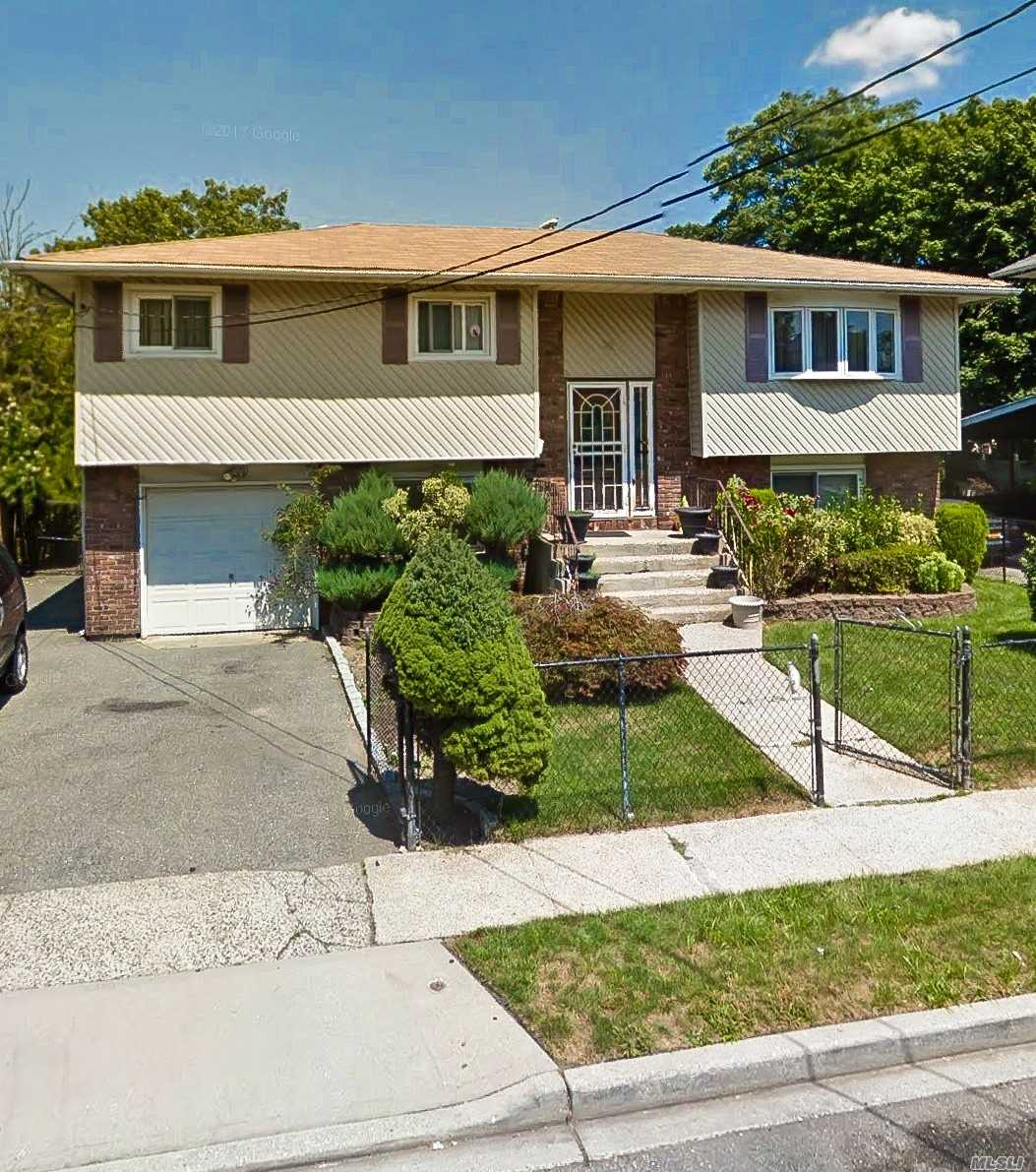 This Well Kept Hi-Ranch Will Not Last It Is A Perfect Mother Daughter With 5 Bedrooms And Two Kitchens. The Yard Is Spacious And A Great Entertaining Area For Guests. Close To Molly College And Grand Ave.
