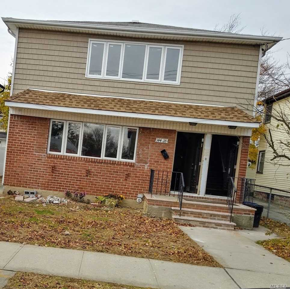 Lovely And Spacious 2 Family House Located On A Tree Lined Block. A Must See.