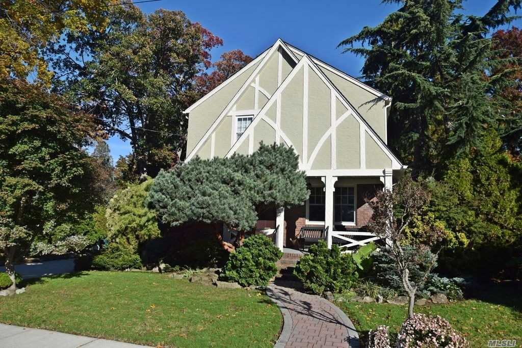 Beautiful Tudor Style Home Located In The Heart Of The Malverne Village. This Home Is On A Oversized Lot Which Is Covered With An Exquisite Landscaped Garden. The First Floor Boasts A Large Living Space, Large Formal Dining Rm, Updated Eik And An Office/Den With Half Bath.The Rooms Are Decorated With Picture Frame Molding, .The Second Fl Has 3 Bedms One Which Has A Large Walk In Closet, Updated Bath With Travertine Tile.Large Spacious Attic. Full Basement W/Updated Utilities.This One Wont Last!
