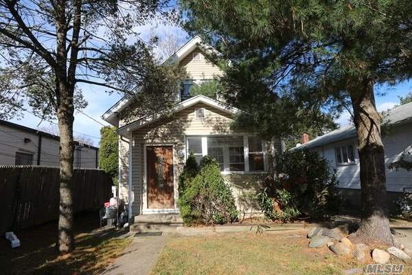 Charming Colonial In The Prestigious Roslyn School District. This Home Features Family/Living Room, Office/Bedroom With Fireplace, Renovated Kitchen W/Granite Counters, 2 Bedrooms Upstairs With Full Bath. Membership To The Highly Sought After East Hills Pool/Park. Great Opportunity!