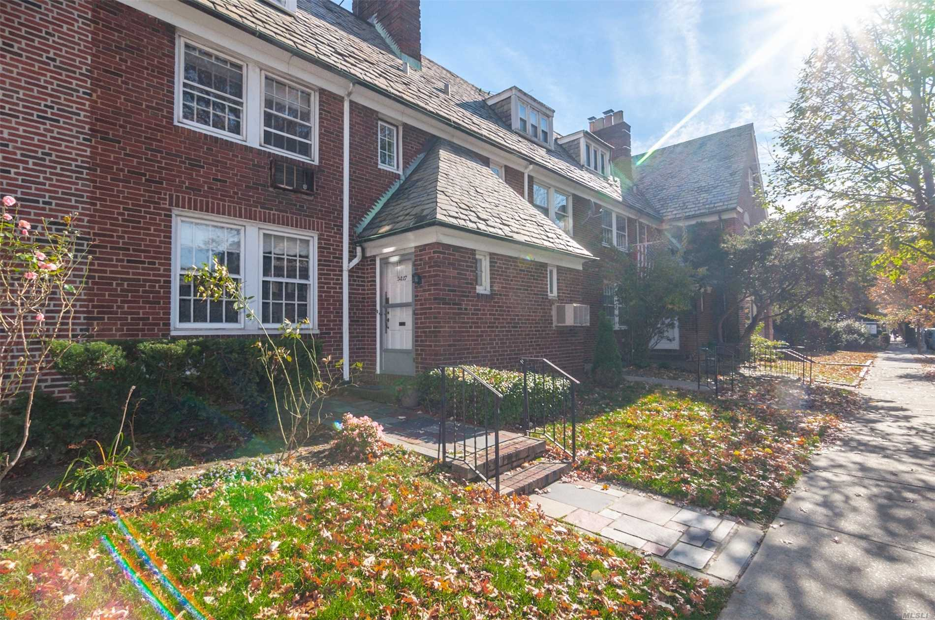 Classic English Garden Row House In Historic Jackson Heights.5 Bedrooms, 3 1/2 Bathrooms, Finished Basement With Full Bath, Working Fireplace, 1 Car Garage, And Additional Parking Outdoor. Close To All Transportation, Shopping, Restaurants, And Airport.