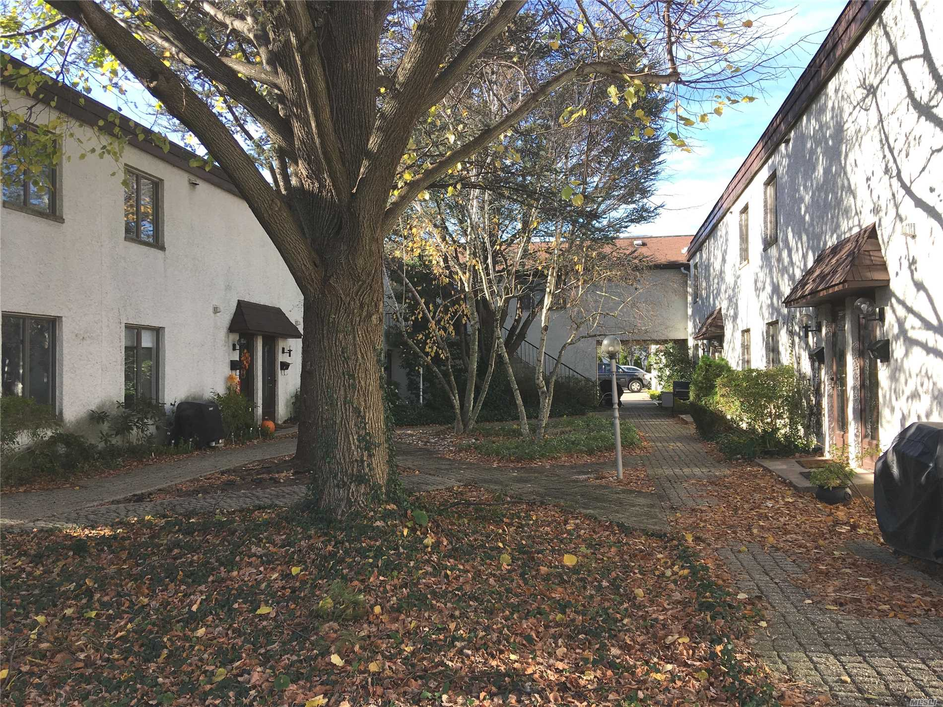 End Unit In Courtyard. 1 Bedroom Loft Apartment On The Creek. Laundry Facility On Premises. Parking Garage Available For Additional Monthly Fee.