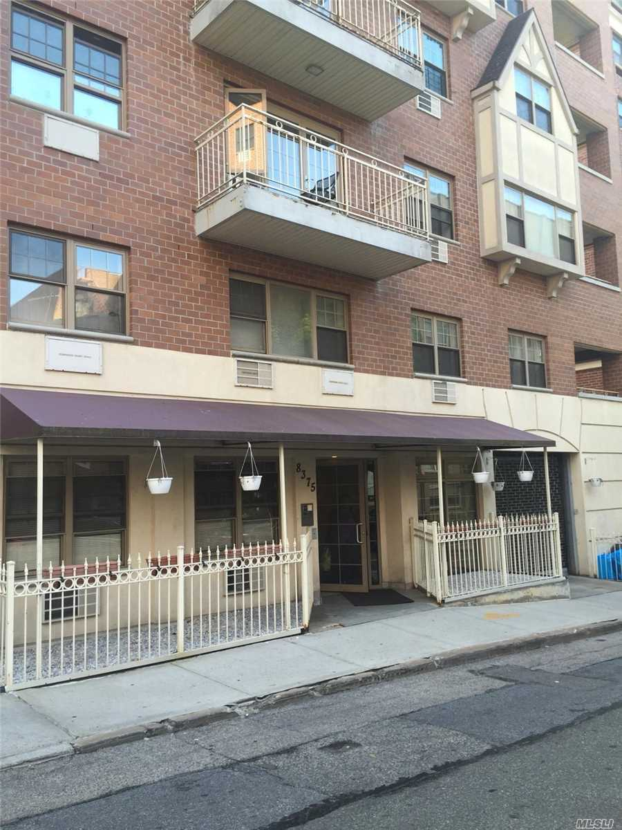 Located Steps From Forest Park, Transportation & Shopping, This 2Br/2Ba Condo Features Hardwood Floors, Balcony, Laundry Room, 1 Deeded Indoor Parking Space & Storage.