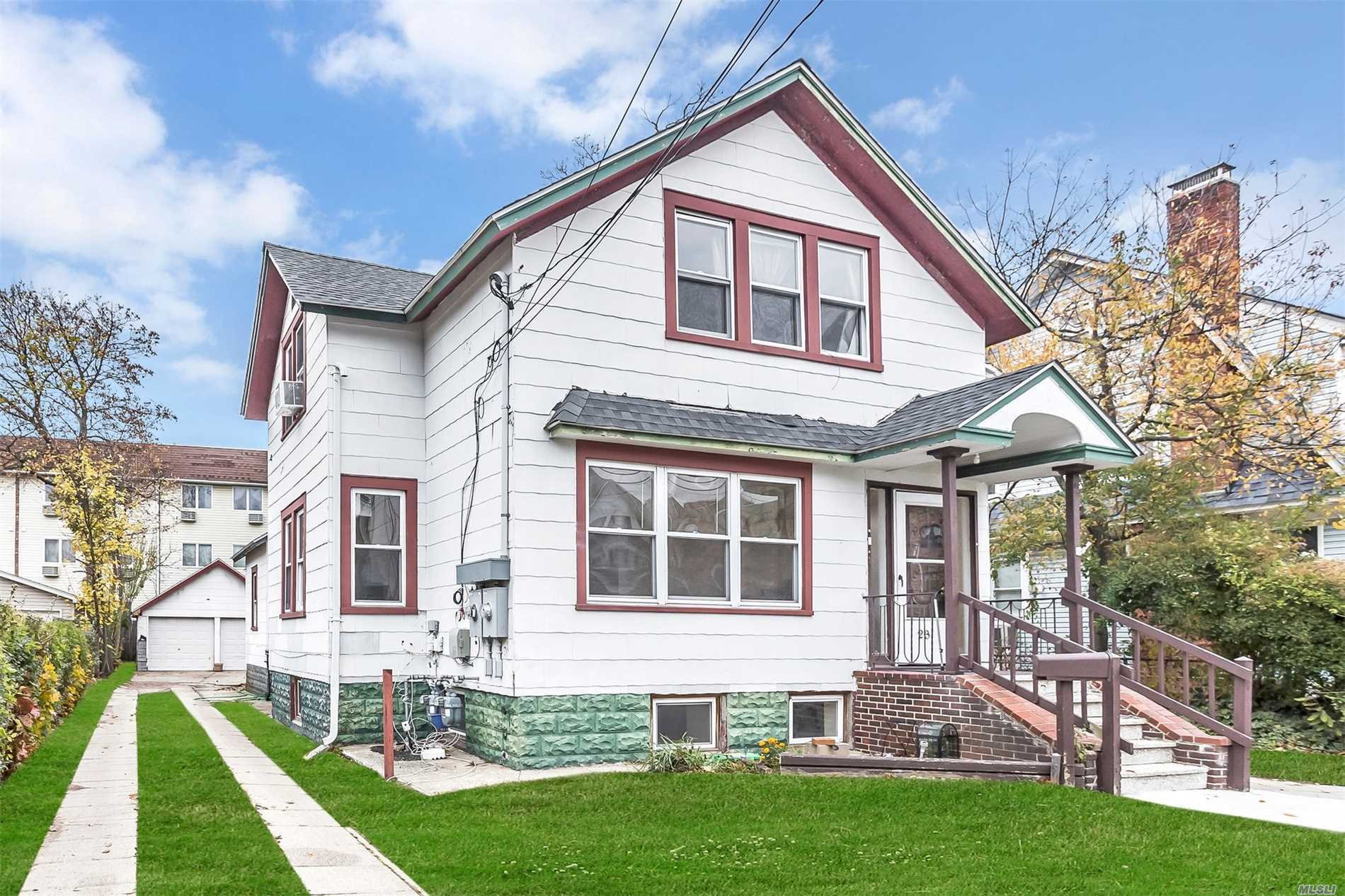 Legal Two Family Offering 3 Bedrooms Each Floor With Oversized Property And A 2 Car Garage, Two Boilers, Separate Electric Meters, Washer And Dryer To Each Unit In Basement, Each Apartment Has Their Own Storage In Basement,  All Utilities Are Separate. Fireplace In Master Bedroom