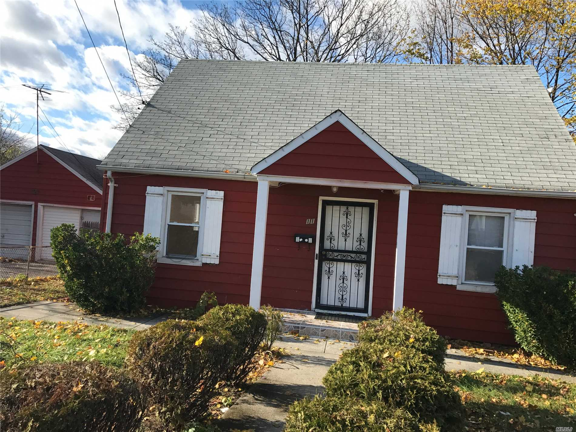 Cape Style House. The First Floor Includes Living Room, New Kitchen W/ Granite Countertop, New Floors, Full Bath And Two Bedrooms. Second Floor Includes Two Bedrooms With Large Closet, New Carpet And New Bathroom. The Basement Fully Finished With Ose.