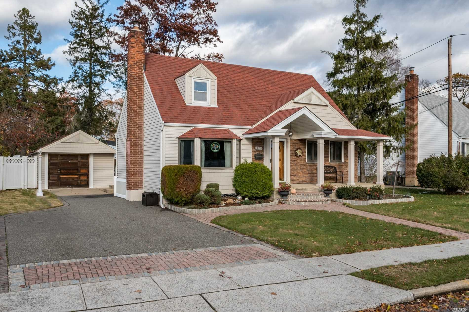 Expanded 4 Bedroom 2 Bath Cape Located In Desirable N. Merrick - Updated Granite Kitchen Opens Up To Dining And Family Room - Sliders Out To Deck And Beautiful O/S Property - Hw Floors, 2 Slim Line Ac's - Paved Walkway, Front Porch, Roof Approx. 8 Years
