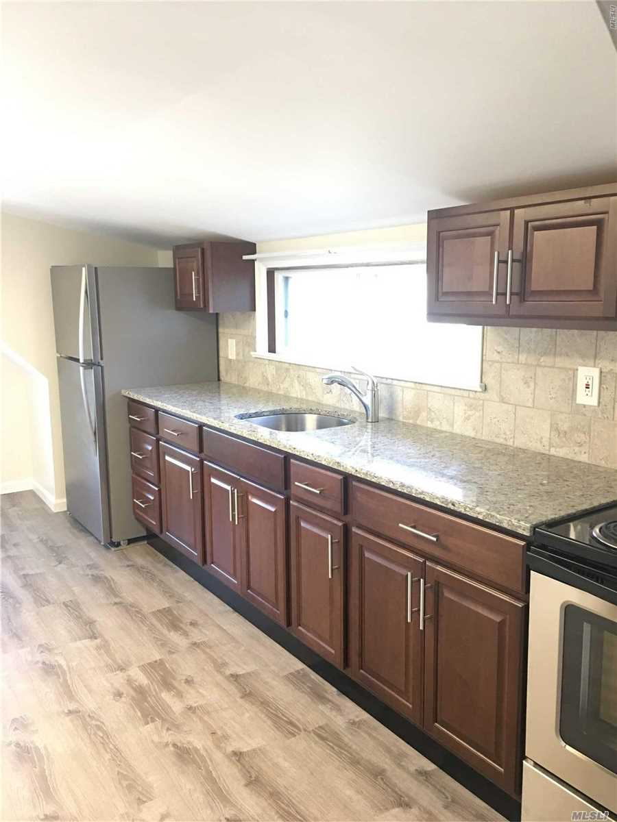 All Redone Northport Village Charmer, Immaculate 1 Bed, Bright, Airy, New Eik, Updated Bath, All New Carpets. Third Floor Walk- Up. Designated Off Street Parking