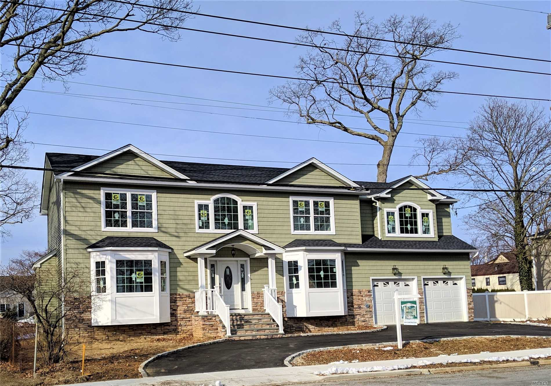 Massapequa Woods Energy Star New Construction In Mass Sd#23. Lg circular driveway w/2 car gar & dramatic circular staircase In 2 story foyer. Quality workmanship Incl oak stairs & banister in bsmt, built ins by fpl In great Rm & mud rm & Pella wndws. Conv To RR & major Roadways / mid block location. A dream of a master suite w/lrg WIC, Dbl closet & fbth. Laundry on 2nd floor. New dark stainless Samsung Appl inc French door fridge. Stainless farm sink. 2 zone gas heat & CAC. Very near completion.