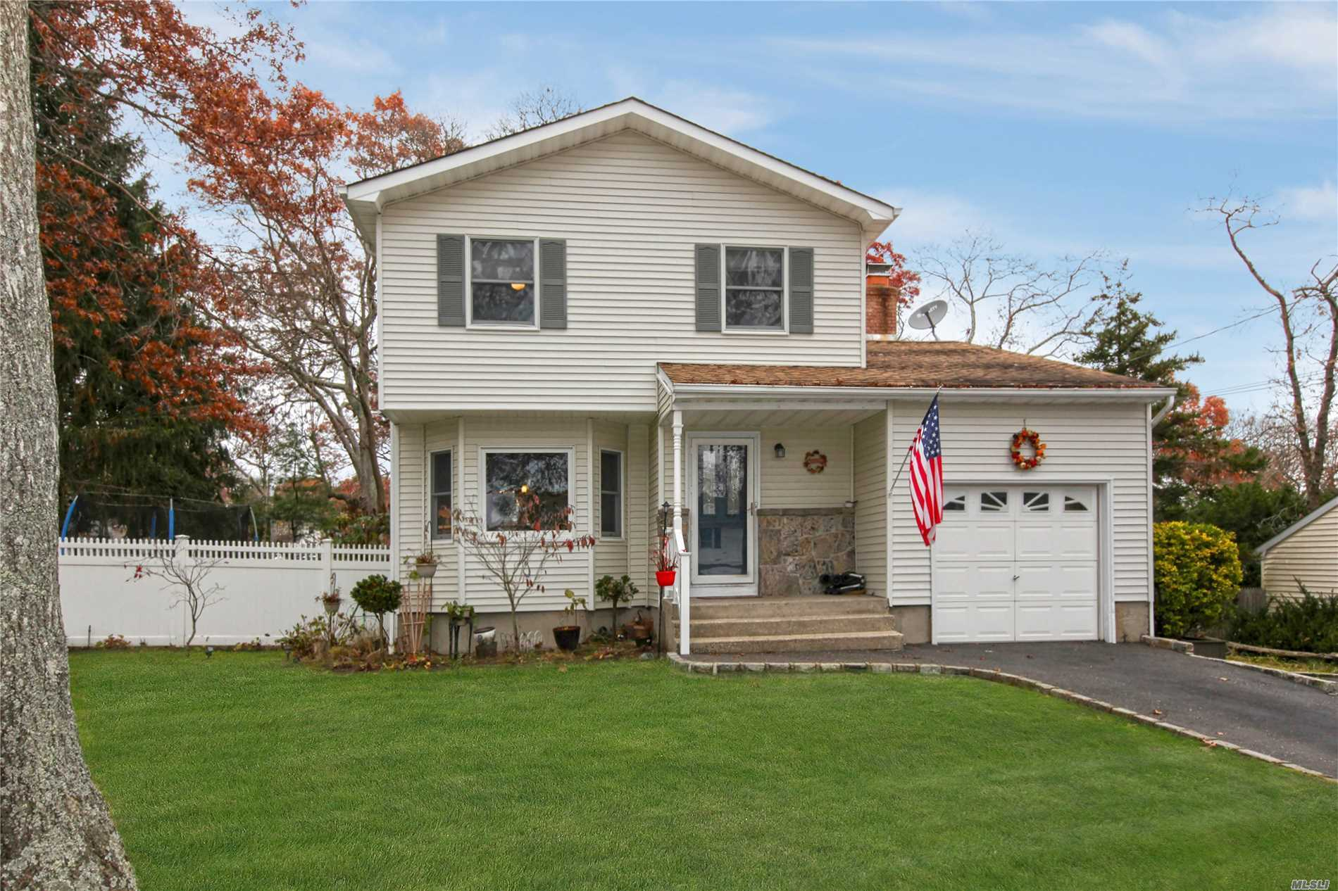 Beautiful Colonial In The Village Of Lake Grove Featuring Hardwood Floors, Kitchen W/ Granite Countertop And Eating Area, Beautiful Den With Fireplace, Nice Sized Master, Finished Basement With Nice Space To Hang Out And Laundry Room. This Home Shows Very Nicely. Very Motivated Sellers