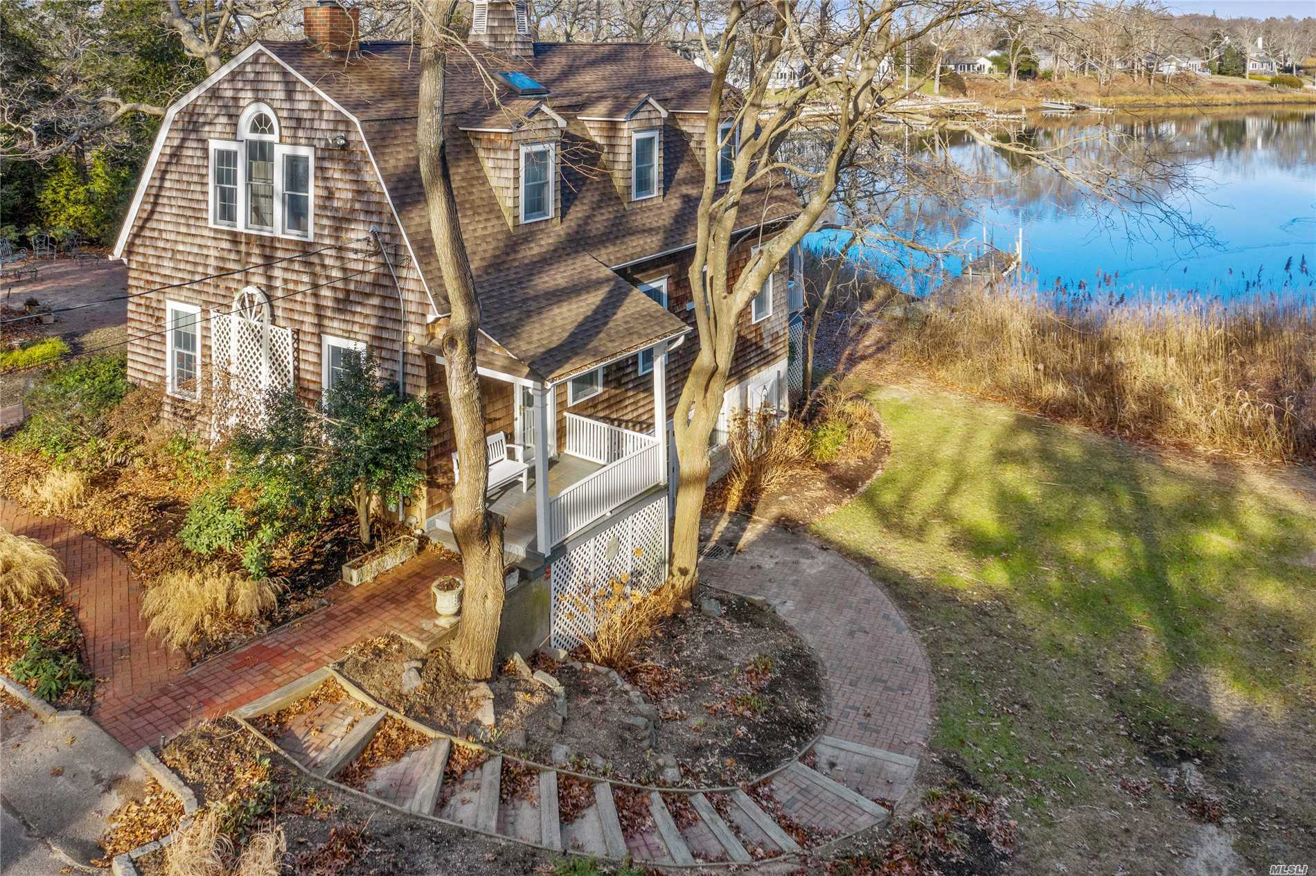 On Deep Hole Creek, This Nantucket Style North Fork Charmer Features 4 Bedrooms, 2 Full Baths, High Ceilings, Spacious Open Layout, Hardwood Floors Throughout, Amazing Waterviews With Direct Bay Access & 2 Car Garage On Shy Acre. Original Carriage House For Adair Lodge. Located Near All The Great Things The North Fork Has To Offer...Beaches, Wineries, Love Lane, & Peconic Bay.