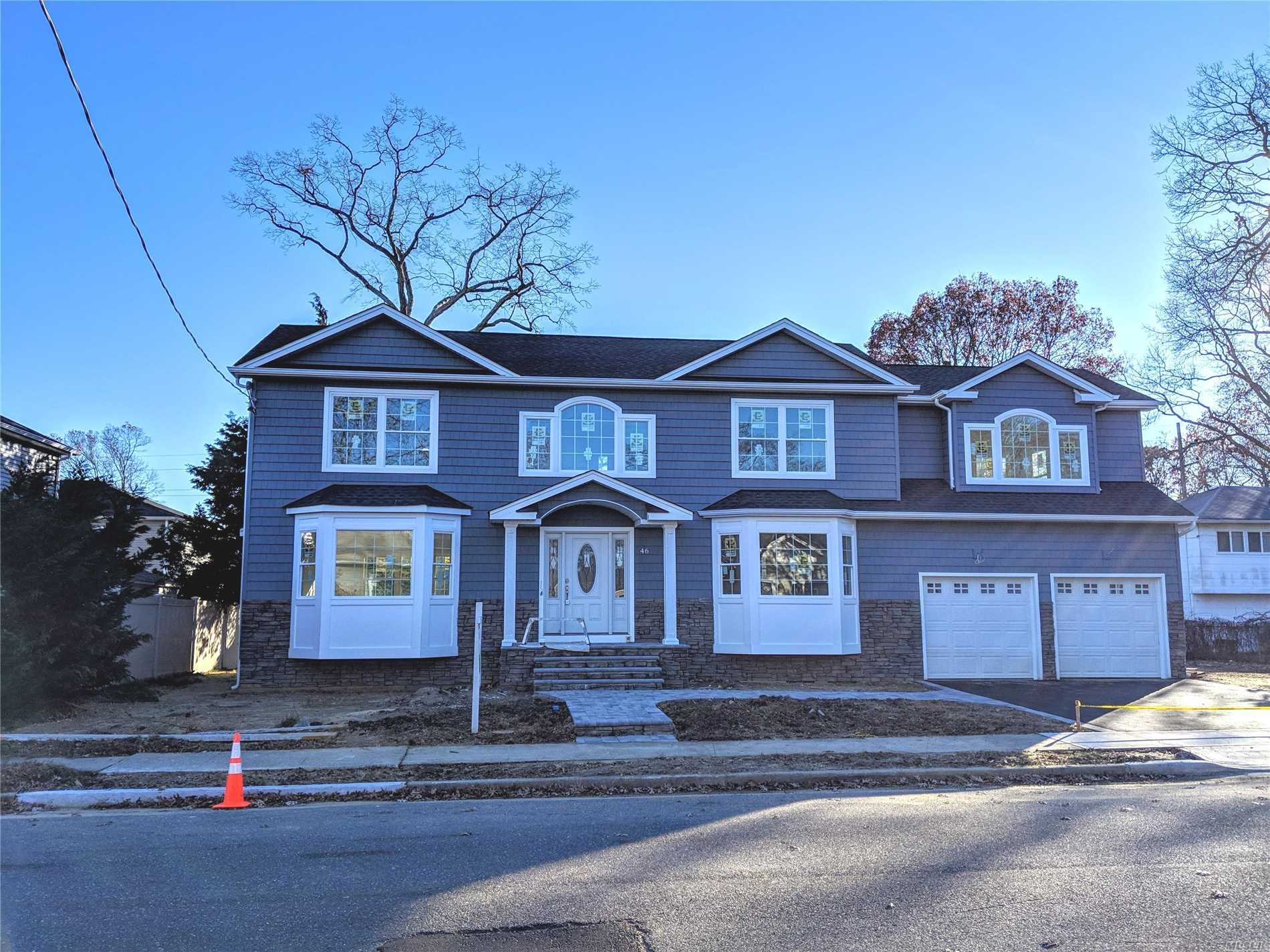 Energy Star New Construction In Mass Woods/Mass Sd #23 Mid Block Location. Ez Access To Train/Prkwys & Shopping, N Of Sunrise Hwy. Many Extra Perks Not Usual To New Constr. Pella Windows, Dramatic 2 Story Foyer W/Circ Stairs, Built Ins By Fpl & In Mud Room, Oak Floors/Banister In Bsmt. 2 Car Gar, Master Suite W/Lrg Wic, Dbl Closet & Full Bath, 2nd Floor Laundry Room. Model Home @ 47 Clark Is Similar But Different. Some Pix Are Of Clark For Workmanship Purposes. Time Still To Choose Kitchen!