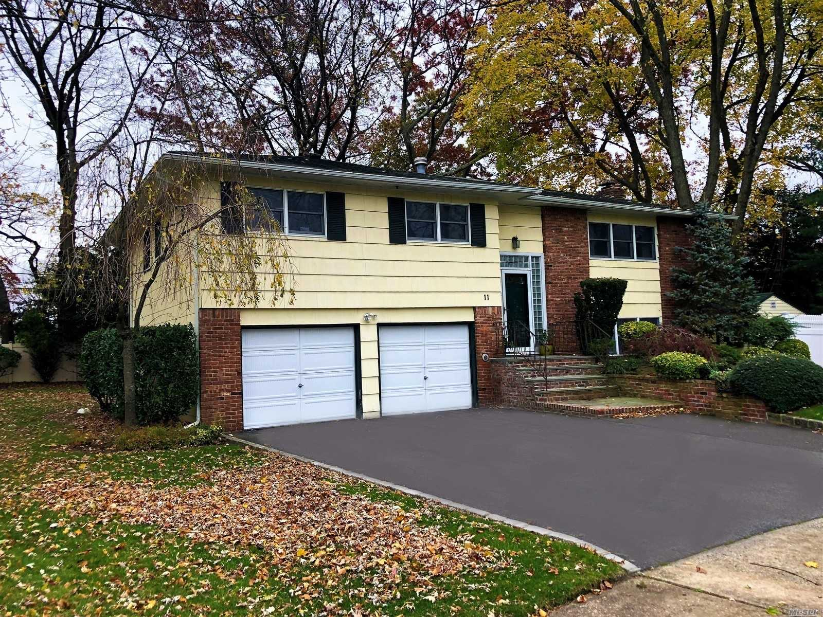 Location, Location, Location! This Lovely Home Features 4 Bedrooms, 3 Baths In A Quiet Cul-De-Sac, Syosset Schools. Hardwood Floors, Cac, Igs, 2 Car Garage, Alarm, Generator.