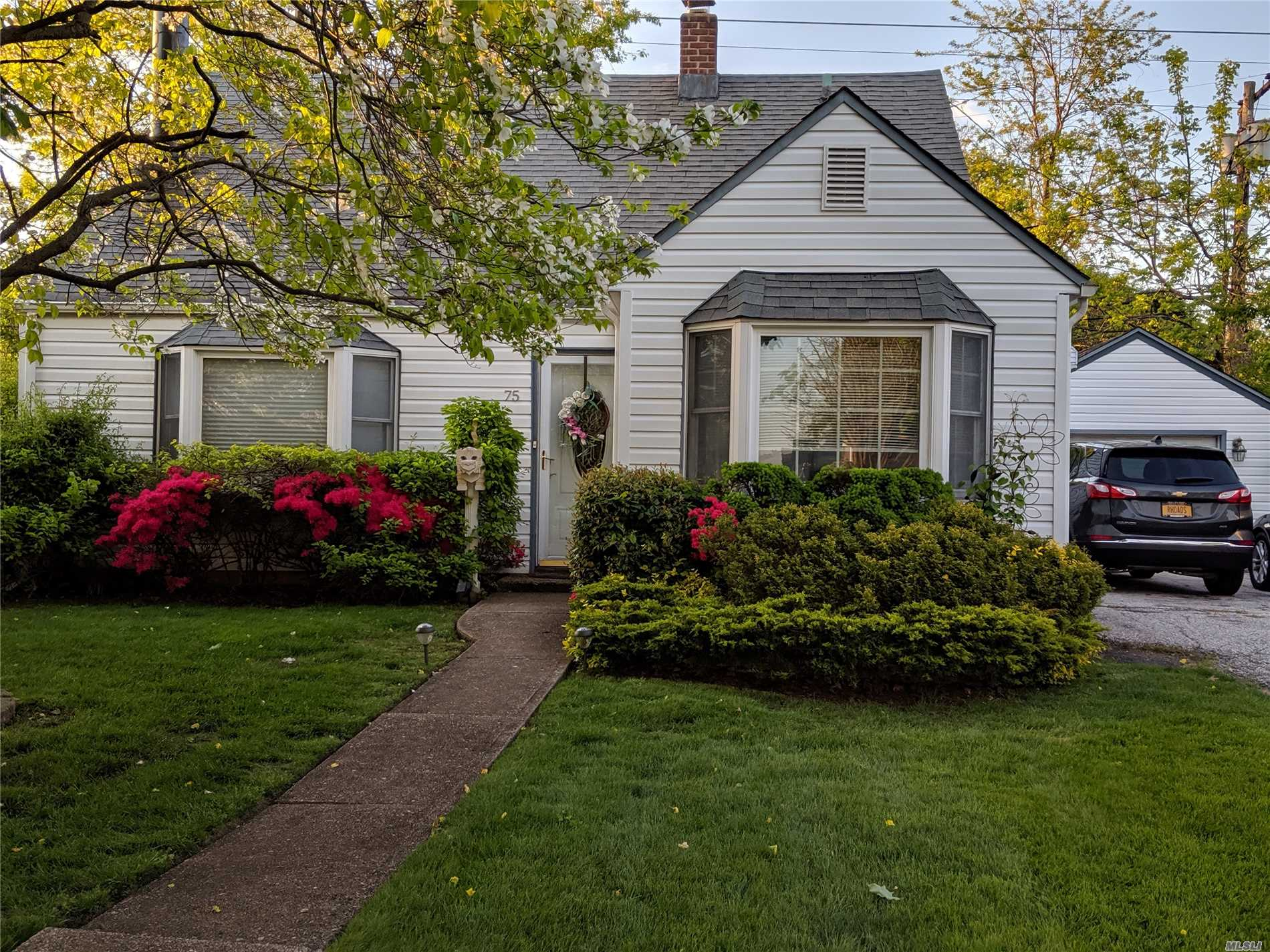 Must See This Expanded New Englander. Offering Updated Extended Kitchen. Expanded Great Room Opening To Deck And Yard. Custom Fireplace. Many Major Updates New Full Bath. Wow Low Taxes Do Not Reflect Star Savings !! Close To All Levittown Pools With Parks, Shopping, Schools and Major Parkways.LOW LOW TAXES!!!